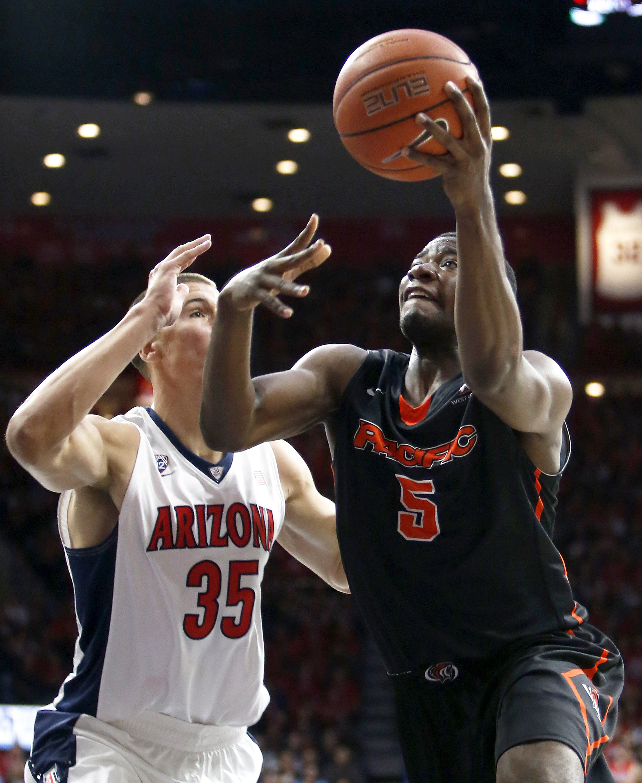 Pacific forward Anthony Townes (5) shoots against Arizona center Kaleb Tarczewski during the first half of an NCAA college basketball game, Friday, Nov. 13, 2015, in Tucson, Ariz. (AP Photo/Rick Scuteri)