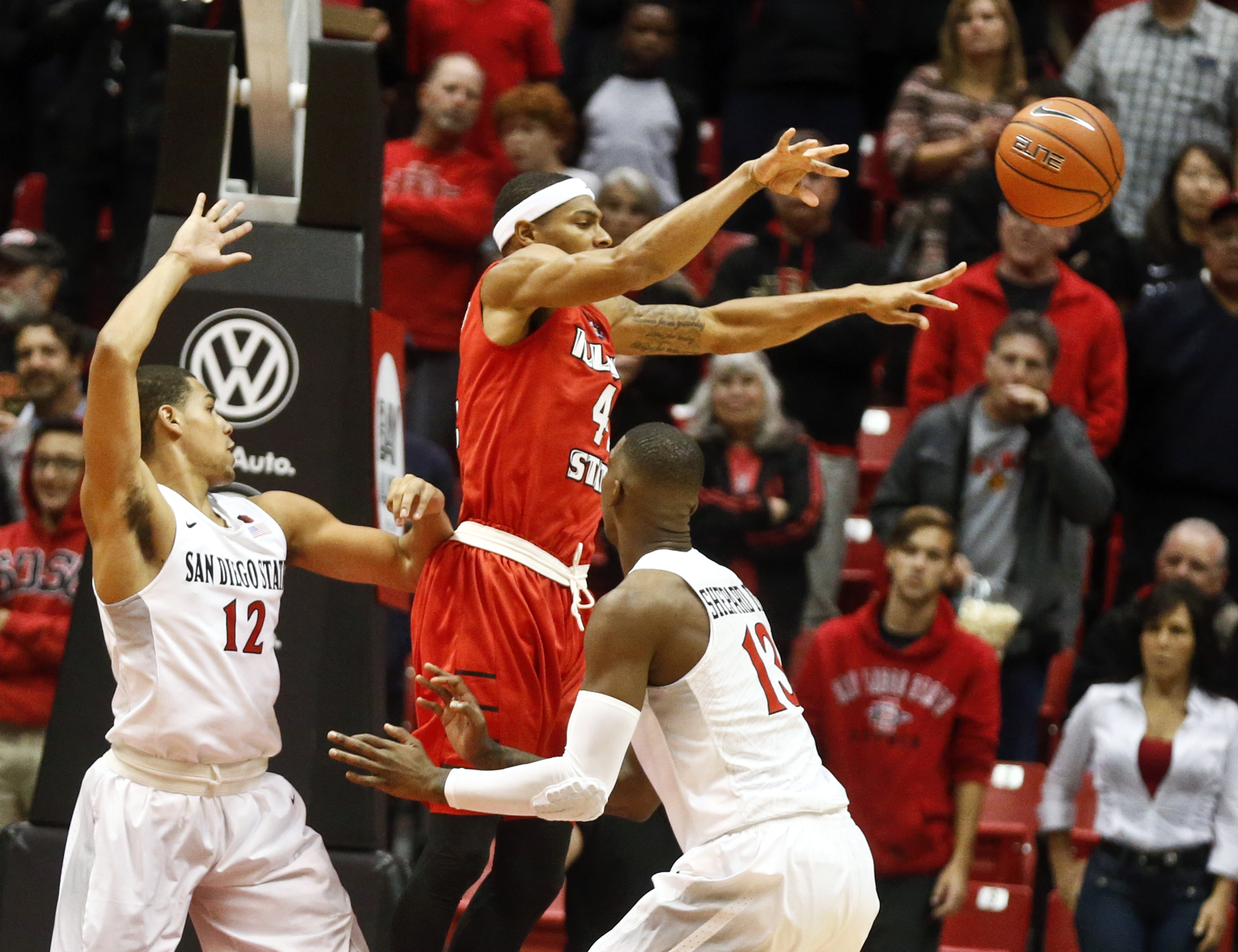 Illinois State guard DeVaughn Akoon-Purcell passes as San Diego State guard Trey Kell, left. and forward Winston Shepard defend in the first half of a NCAA college basketball game Friday, Nov. 13, 2015, in San Diego.  (AP Photo/Lenny Ignelzi)