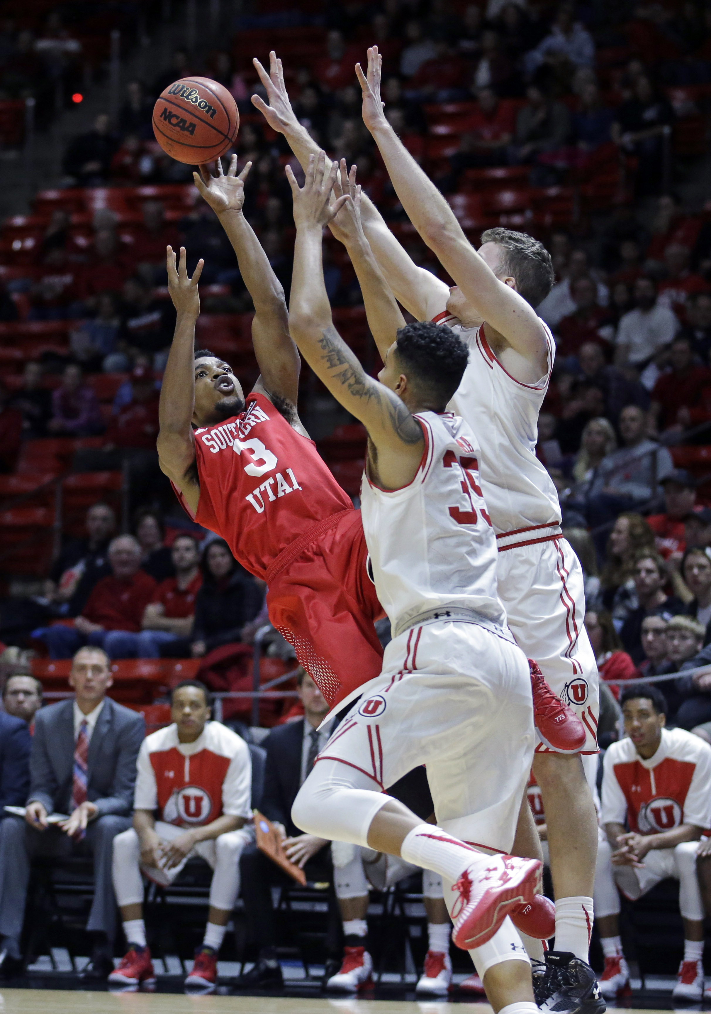 Southern Utah guard Travon Langston (3) shoots as Utah's Kyle Kuzma (35) and Jakob Poeltl, right, defend in first half during an NCAA college basketball game Friday, Nov. 13, 2015, in Salt Lake City. (AP Photo/Rick Bowmer)
