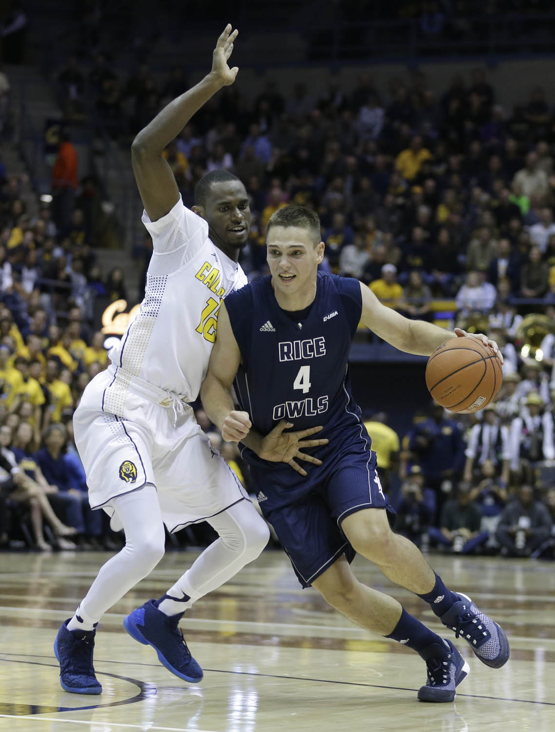 Rice's Egor Koulechov, right, drives the ball past California's Roger Moute a Bidias during the first half of an NCAA college basketball game Friday, Nov. 13, 2015, in Berkeley, Calif. (AP Photo/Ben Margot)