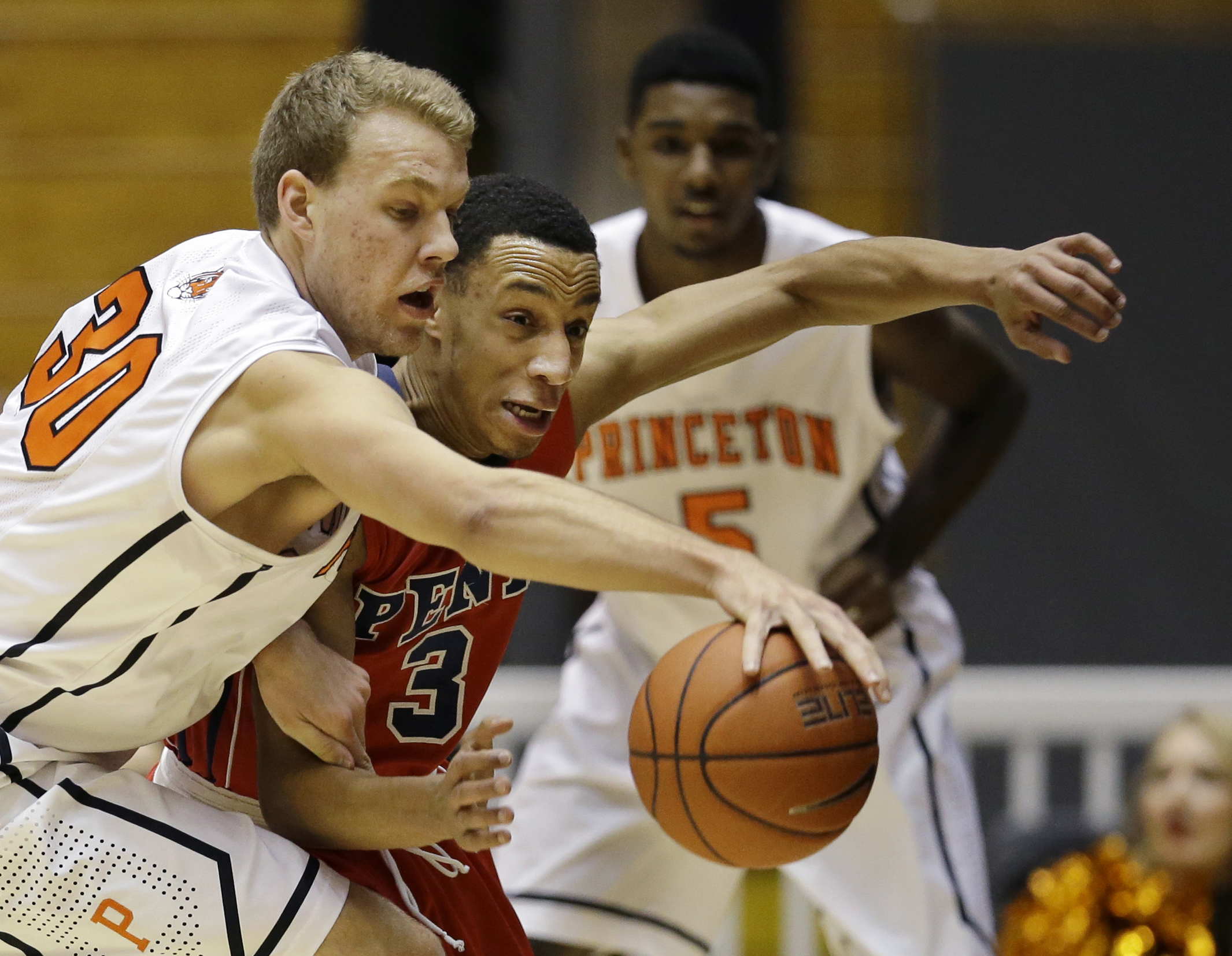 Princeton forward Hans Brase (30) tries to control the ball in front of Penn guard Darnell Foreman (3) during the first half of an NCAA college basketball game Saturday, Jan. 10, 2015, in Princeton, N.J. (AP Photo/Mel Evans)