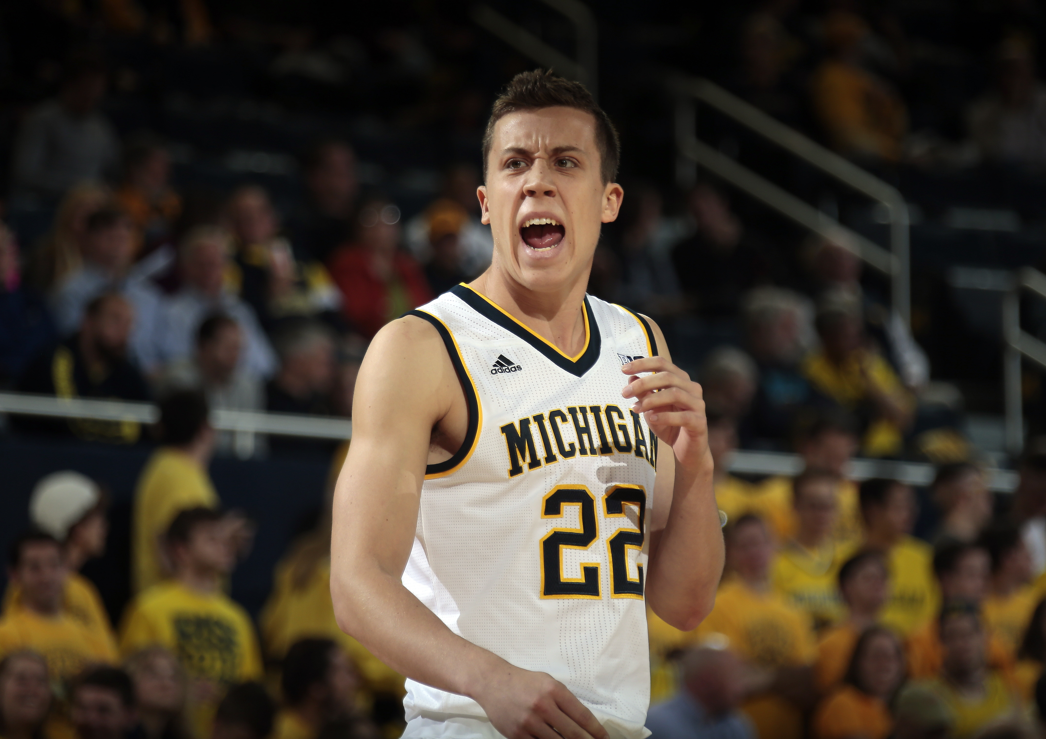 Michigan guard Duncan Robinson (22) reacts after a play in the first half of an NCAA college basketball game against Elon at Crisler Center in Ann Arbor, Mich., Monday, Nov. 16, 2015.  (AP Photo/Tony Ding)