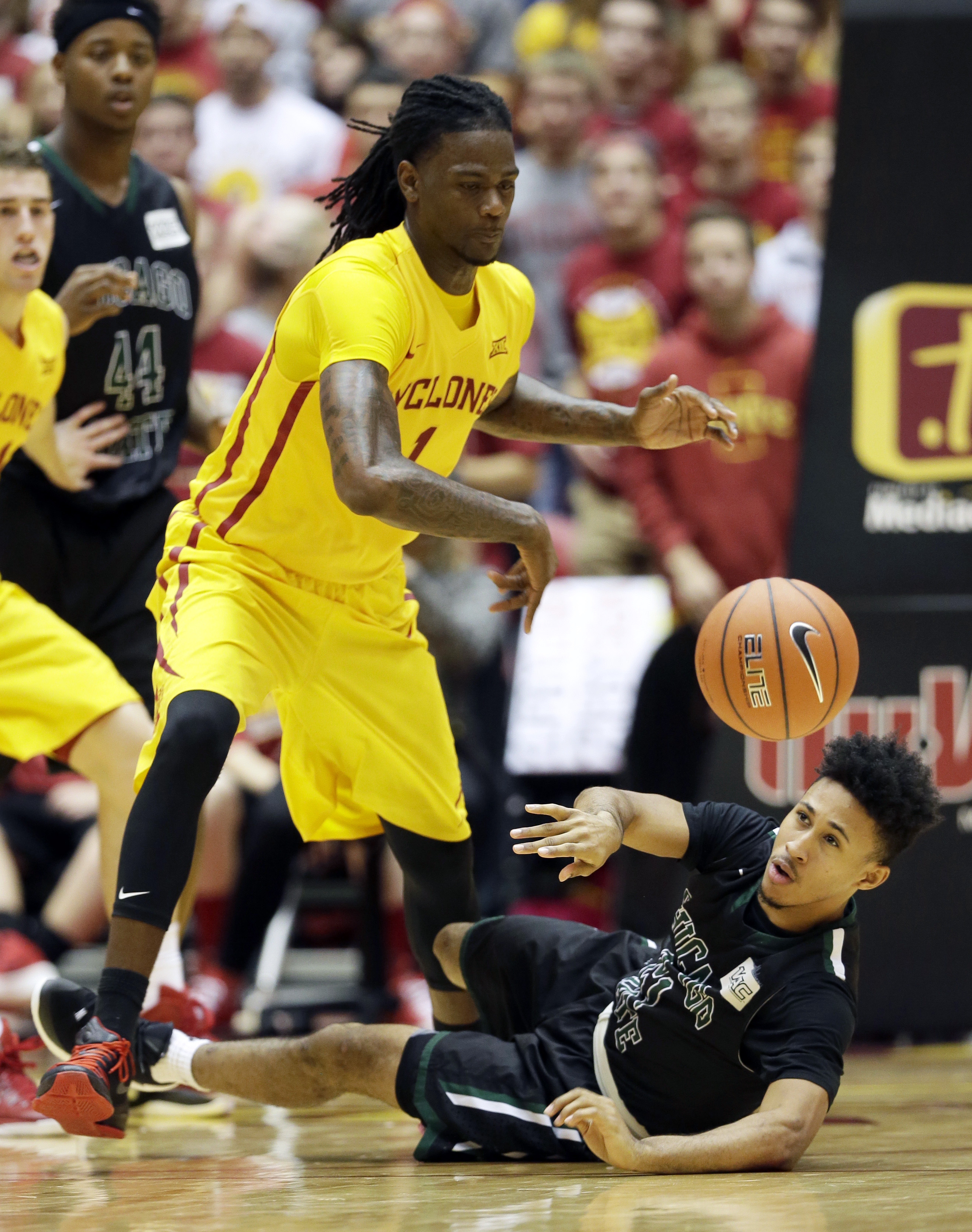 Chicago State guard Joshua Batson, right, loses the ball in front of Iowa State forward Jameel McKay, left, during the first half of an NCAA college basketball game, Monday, Nov. 16, 2015, in Ames, Iowa. (AP Photo/Charlie Neibergall)