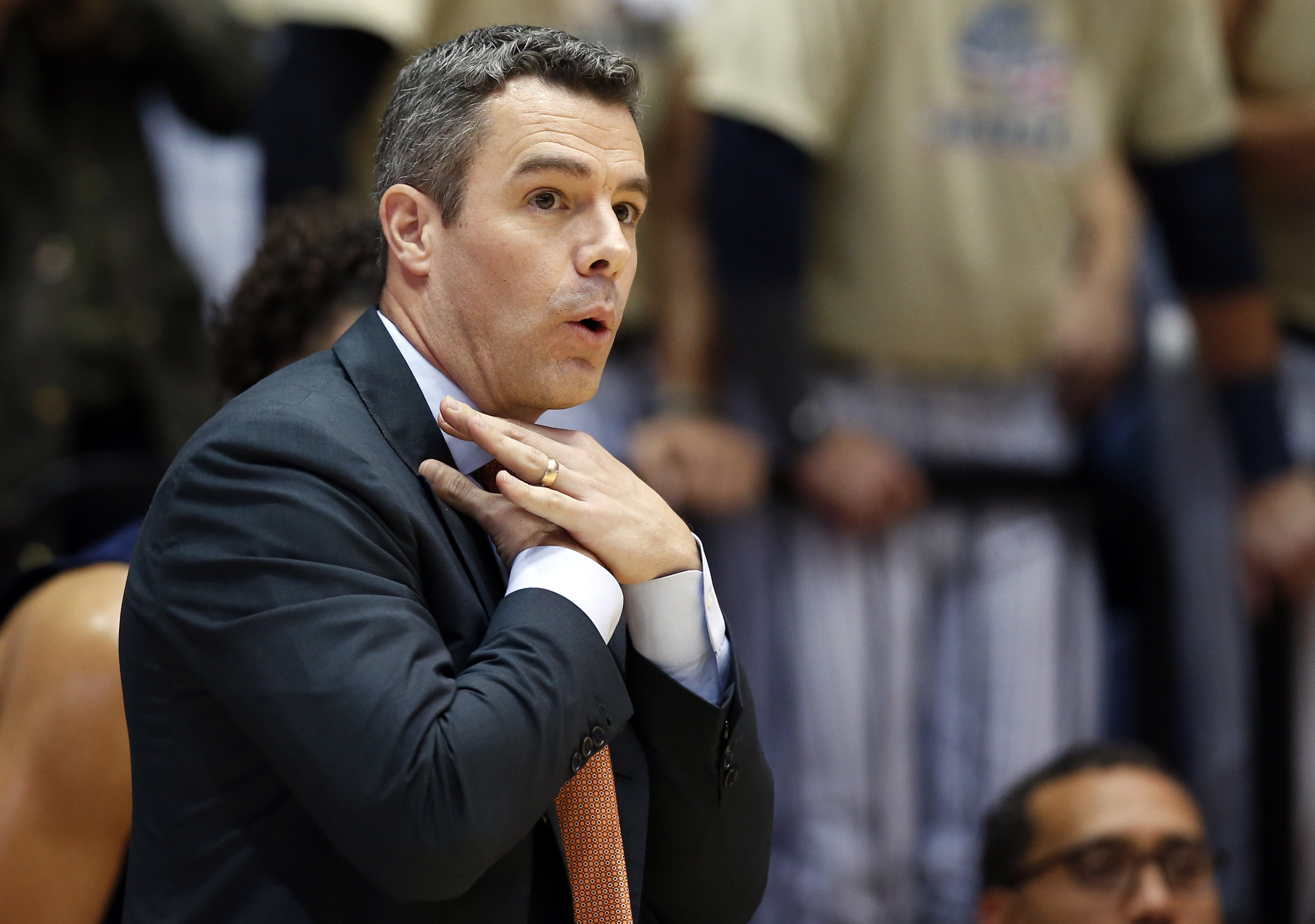 Virginia head coach Tony Bennett reacts during the first half of an NCAA college basketball game against George Washington, Monday, Nov. 16, 2015, in Washington. George Washington won 73-68. (AP Photo/Alex Brandon)