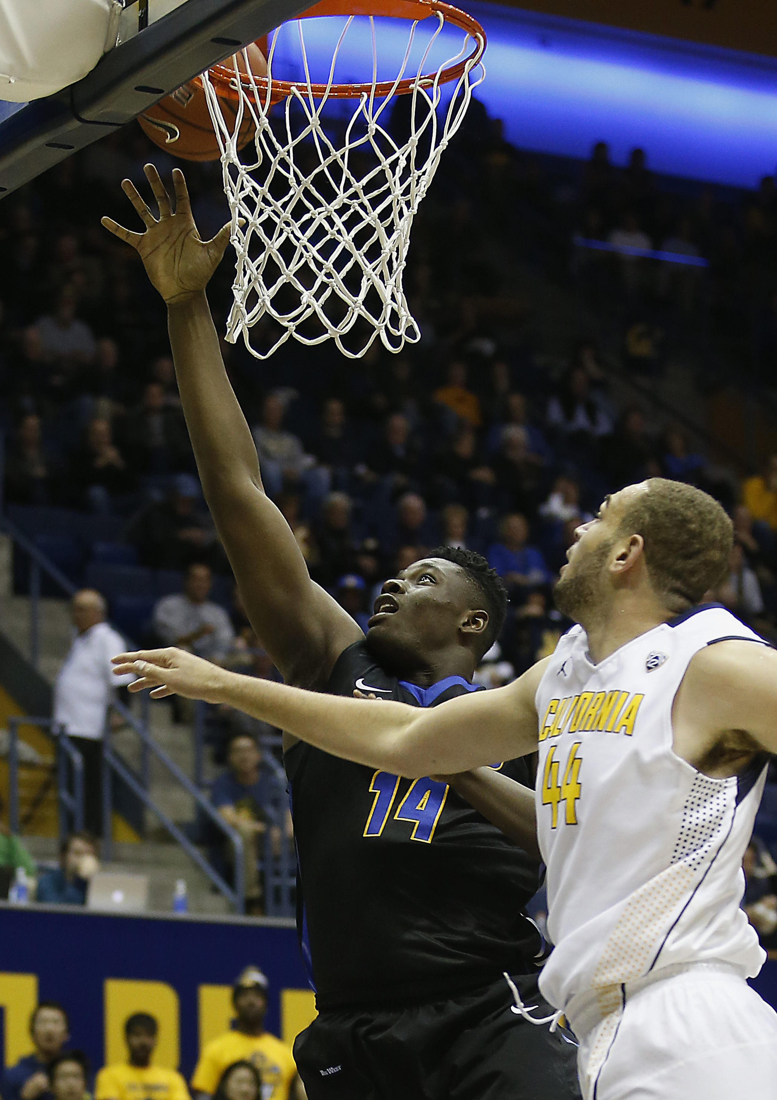 UC Santa Barbara forward Ami Lakoju (14) shoots over California center Kameron Rooks (44) in the first half of an NCAA college basketball game, Monday, Nov. 16, 2015, in Berkeley, Calif. (AP Photo/Tony Avelar)