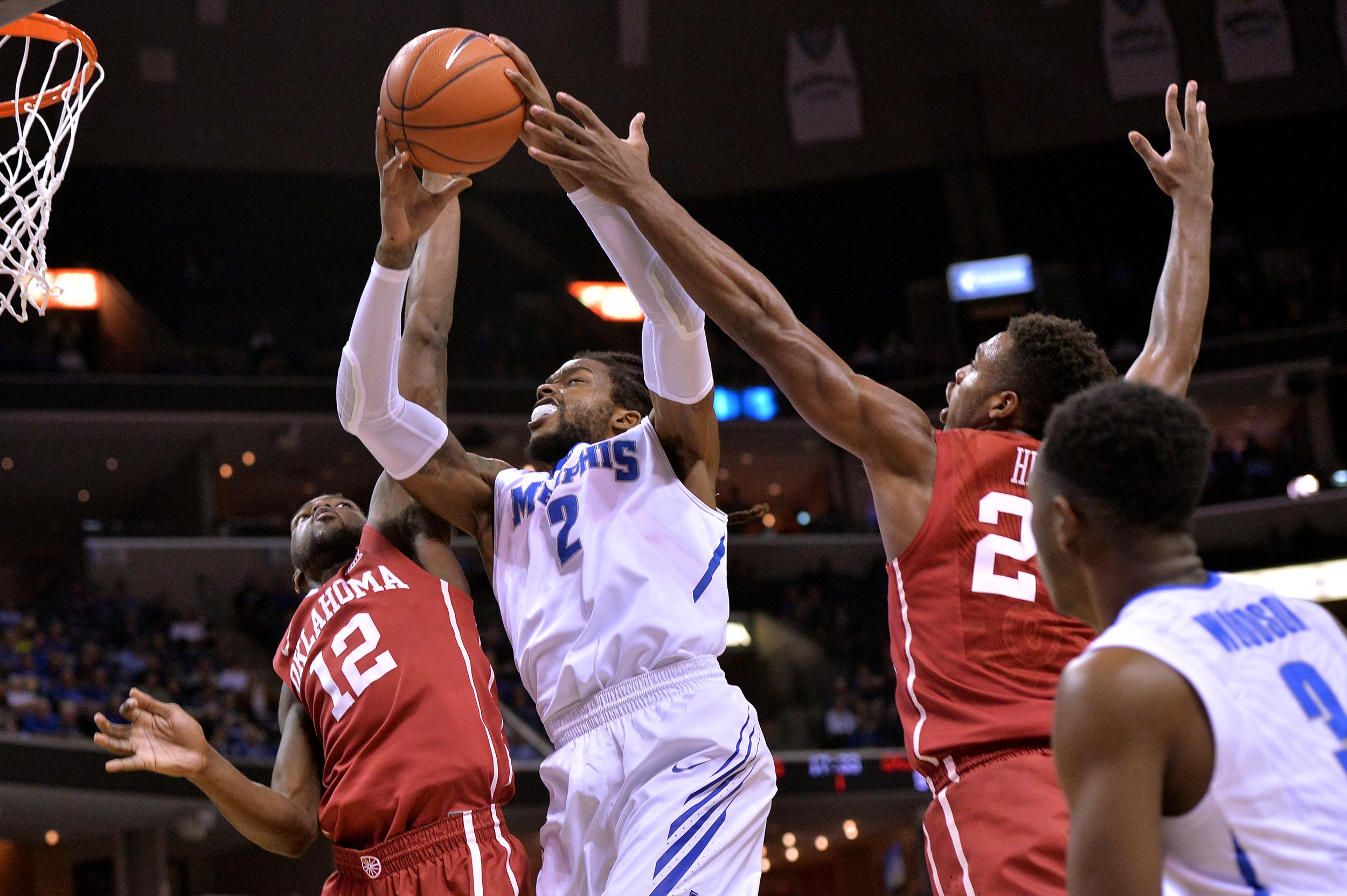 Memphis forward Shaq Goodwin (2) shoots between Oklahoma forward Khadeem Lattin (12) and guard Buddy Hield, right, in the first half of an NCAA college basketball game, Tuesday, Nov. 17, 2015, in Memphis, Tenn. (AP Photo/Brandon Dill)