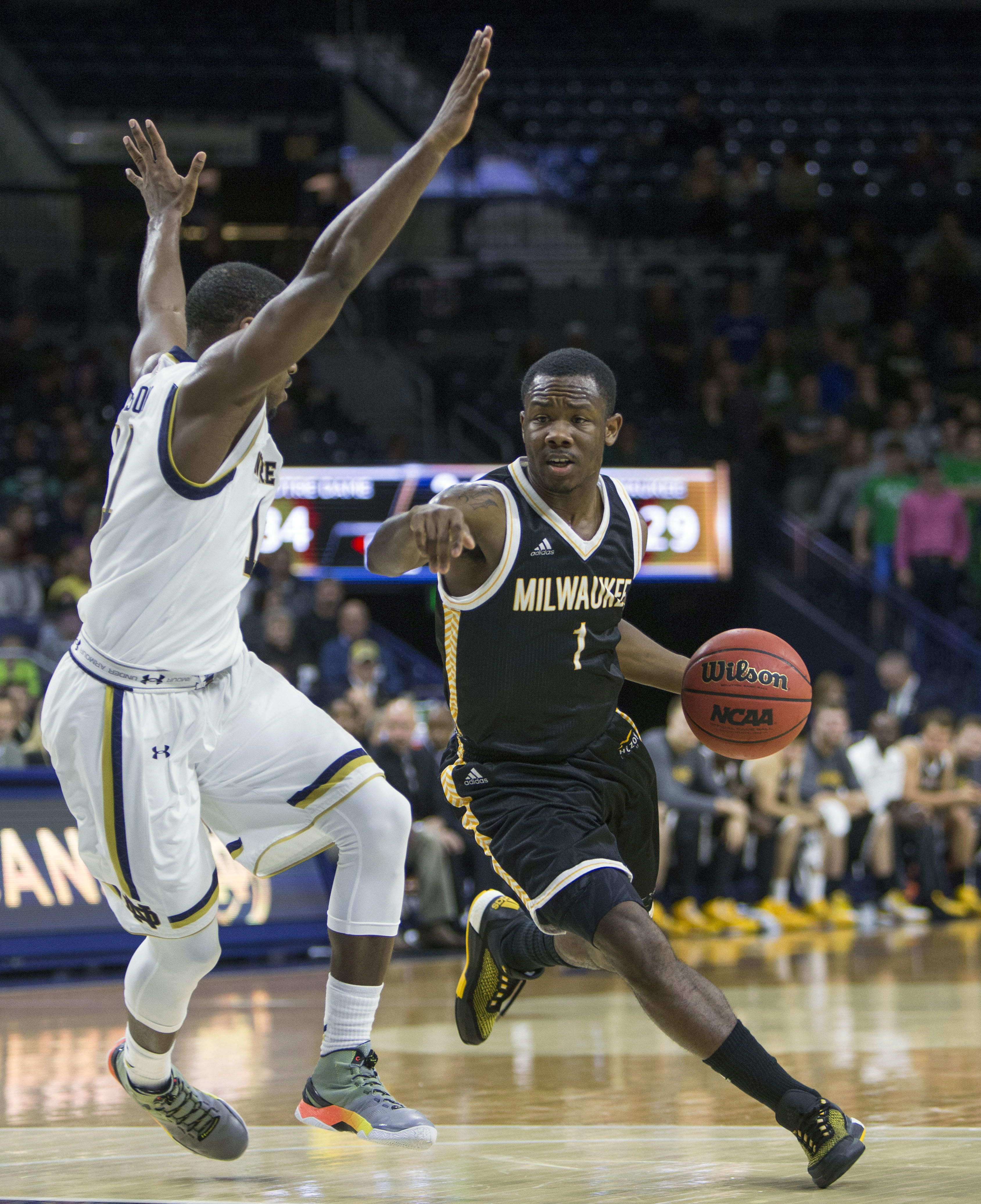 Milwaukee's JordanJohnson (1) moves by Notre Dame's Demetrius Jackson (11) during the first half of an NCAA college basketball game Tuesday, Nov. 17, 2015, in South Bend, Ind.  (AP Photo/Robert Franklin)