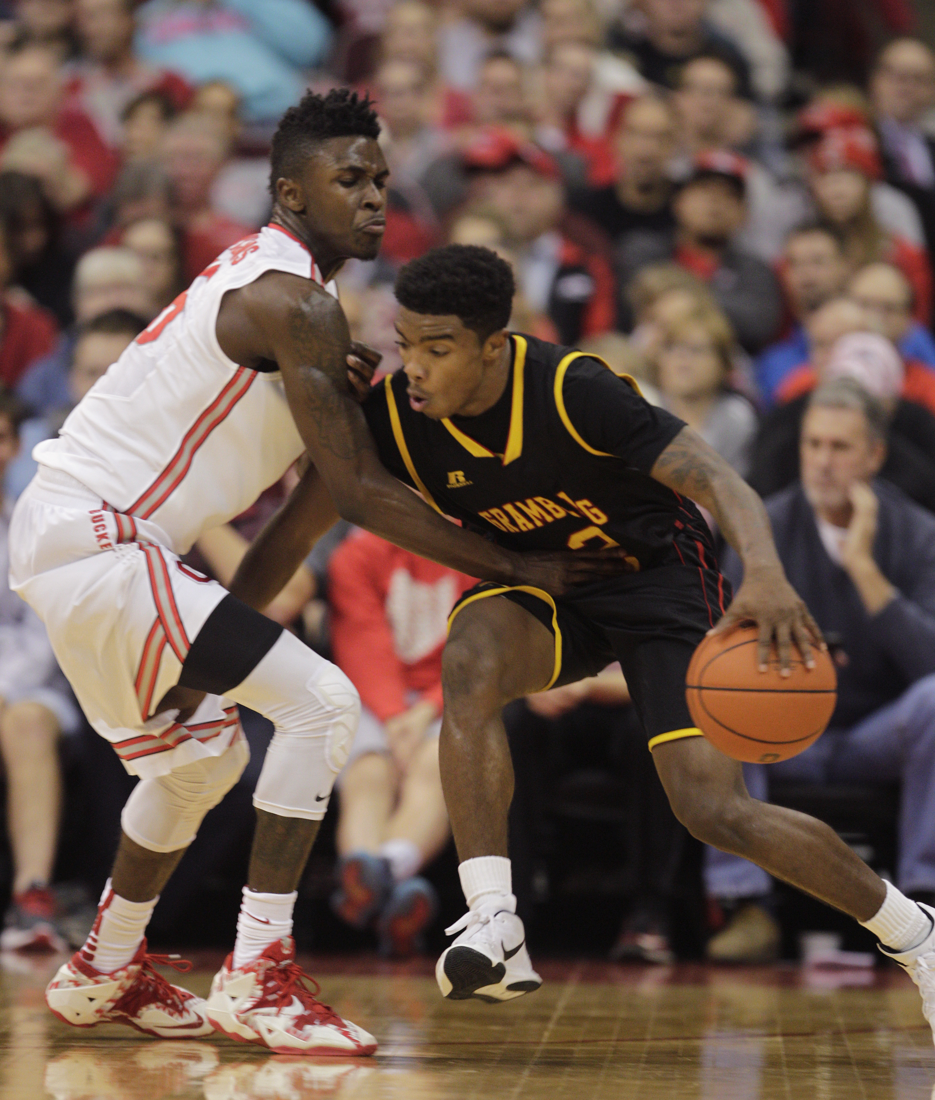 Grambling State's Nigel Ribeiro, right, tries to dribble past Ohio State's Kam Williams during the first half of an NCAA college basketball game Tuesday, Nov. 17, 2015, in Columbus, Ohio. (AP Photo/Jay LaPrete)