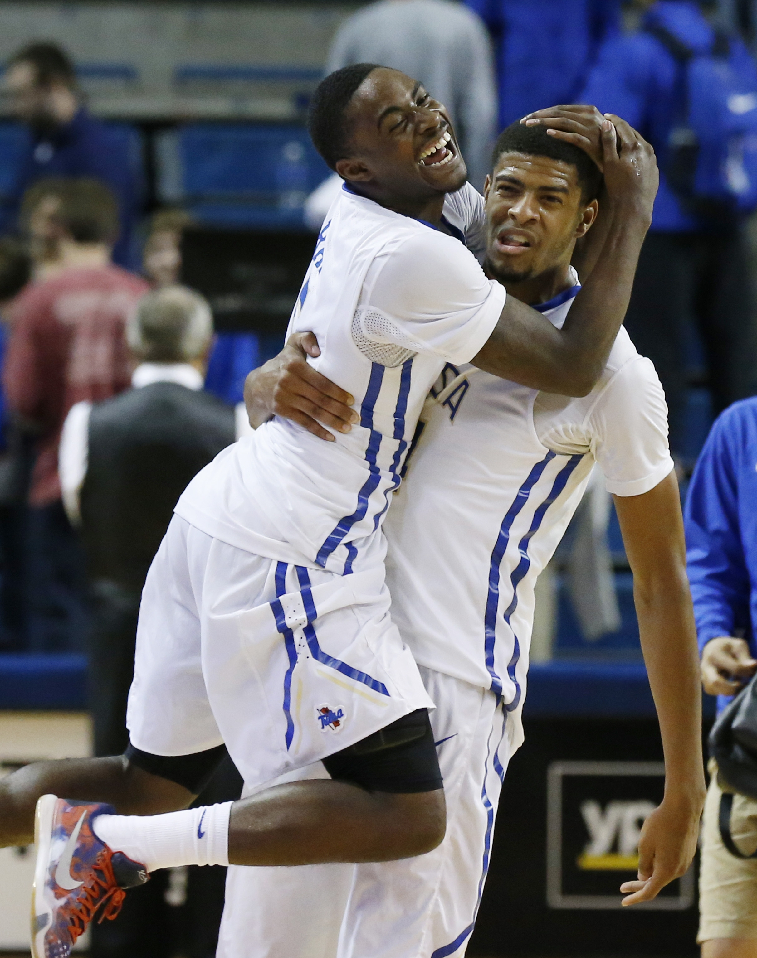 Tulsa's Rashad Ray, left, and Brandon Swannegan, right, celebrate after an NCAA college basketball game against Wichita State in Tulsa, Okla., Tuesday, Nov. 17, 2015. Tulsa won 77-67. (AP Photo/Sue Ogrocki)