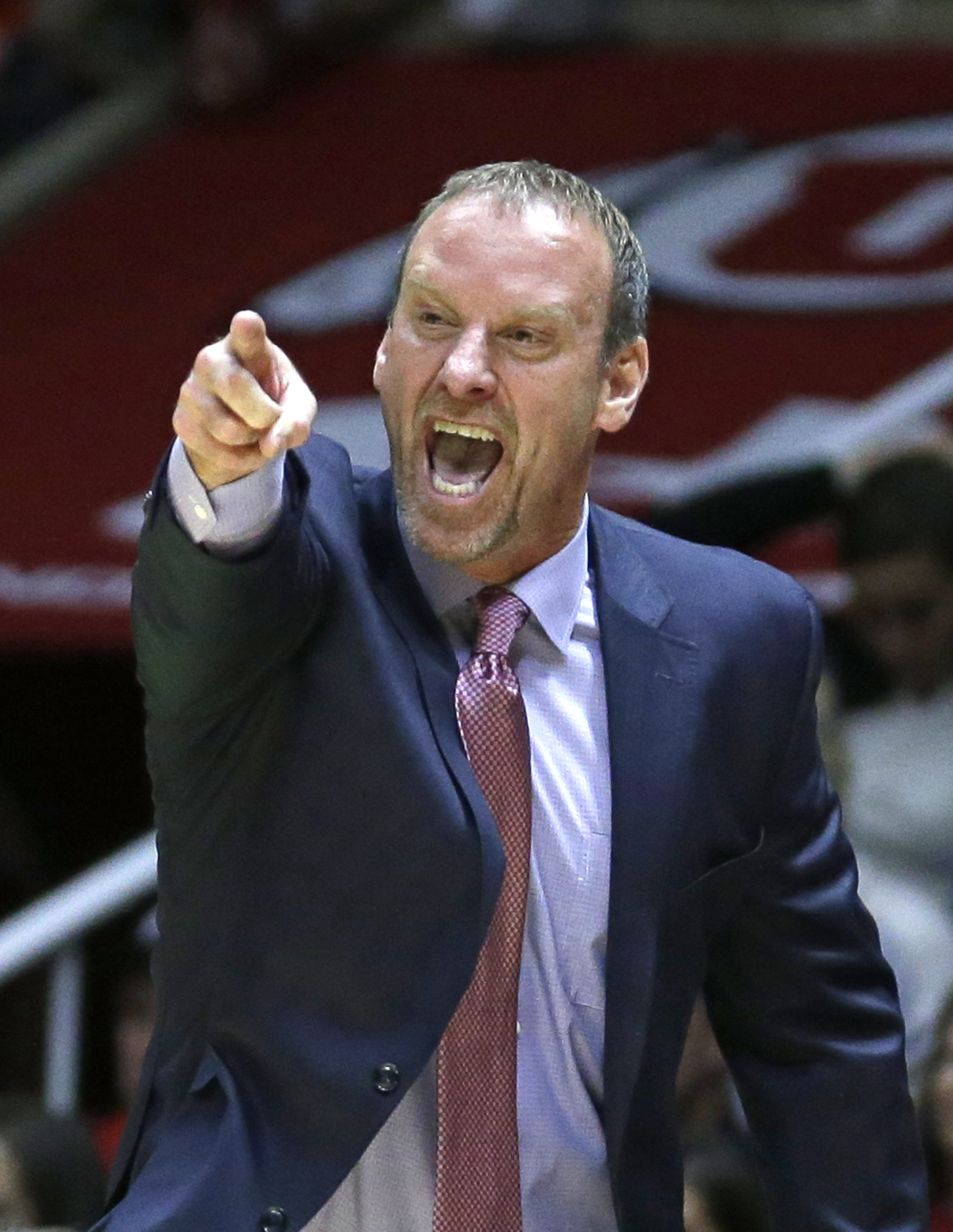 FILE - In this Nov. 13, 2015, file photo, Utah coach Larry Krystkowiak shouts to his team during the second half of an NCAA college basketball game against Southern Utah, in Salt Lake City. Utah begins play Thursday, Nov. 19 in the Puerto Rico Tipoff, whi