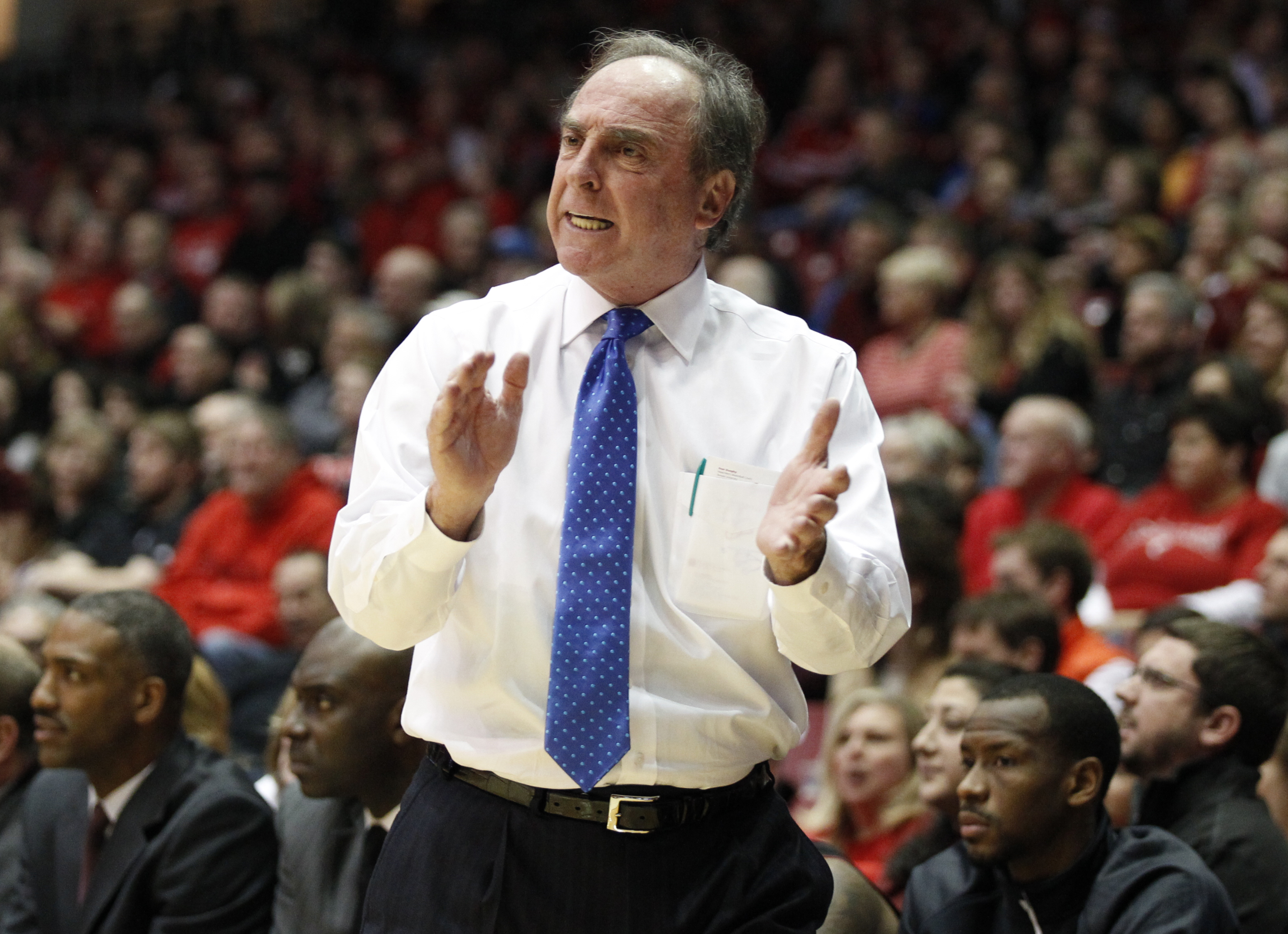FILE - In this Jan. 17, 2015, file photo, Temple head coach Fran Dunphy cheers his team during the first half of their NCAA college basketball game against Cincinnati, in Cincinnati. Temple begins play Thursday, Nov. 19 in the Puerto Rico Tipoff, which ru