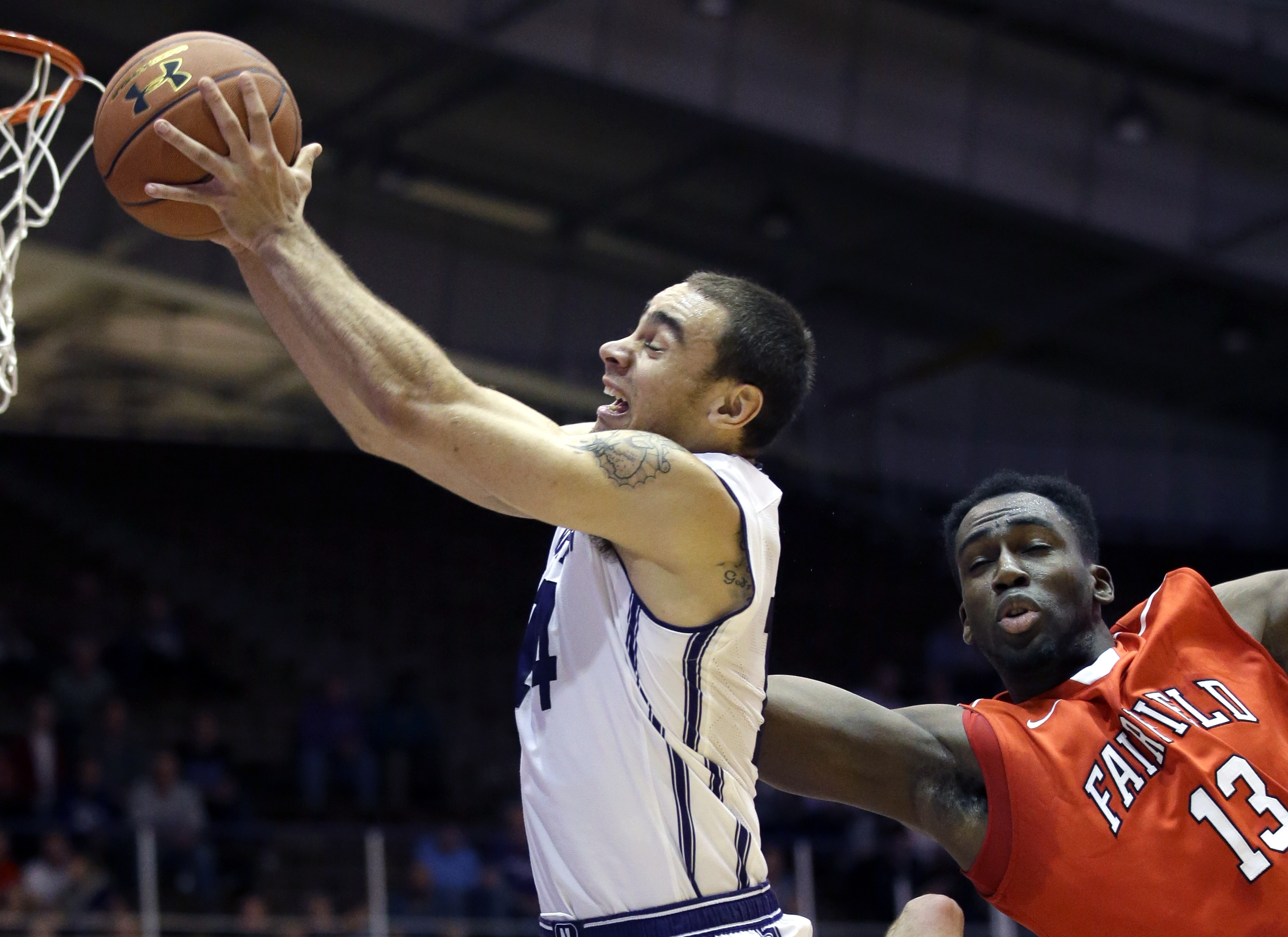 Northwestern guard Tre Demps, left, grabs a rebound against Fairfield forward Jonathan Kasibabu during the first half of an NCAA college basketball game on Wednesday, Nov. 18, 2015, in Evanston, Ill. (AP Photo/Nam Y. Huh)