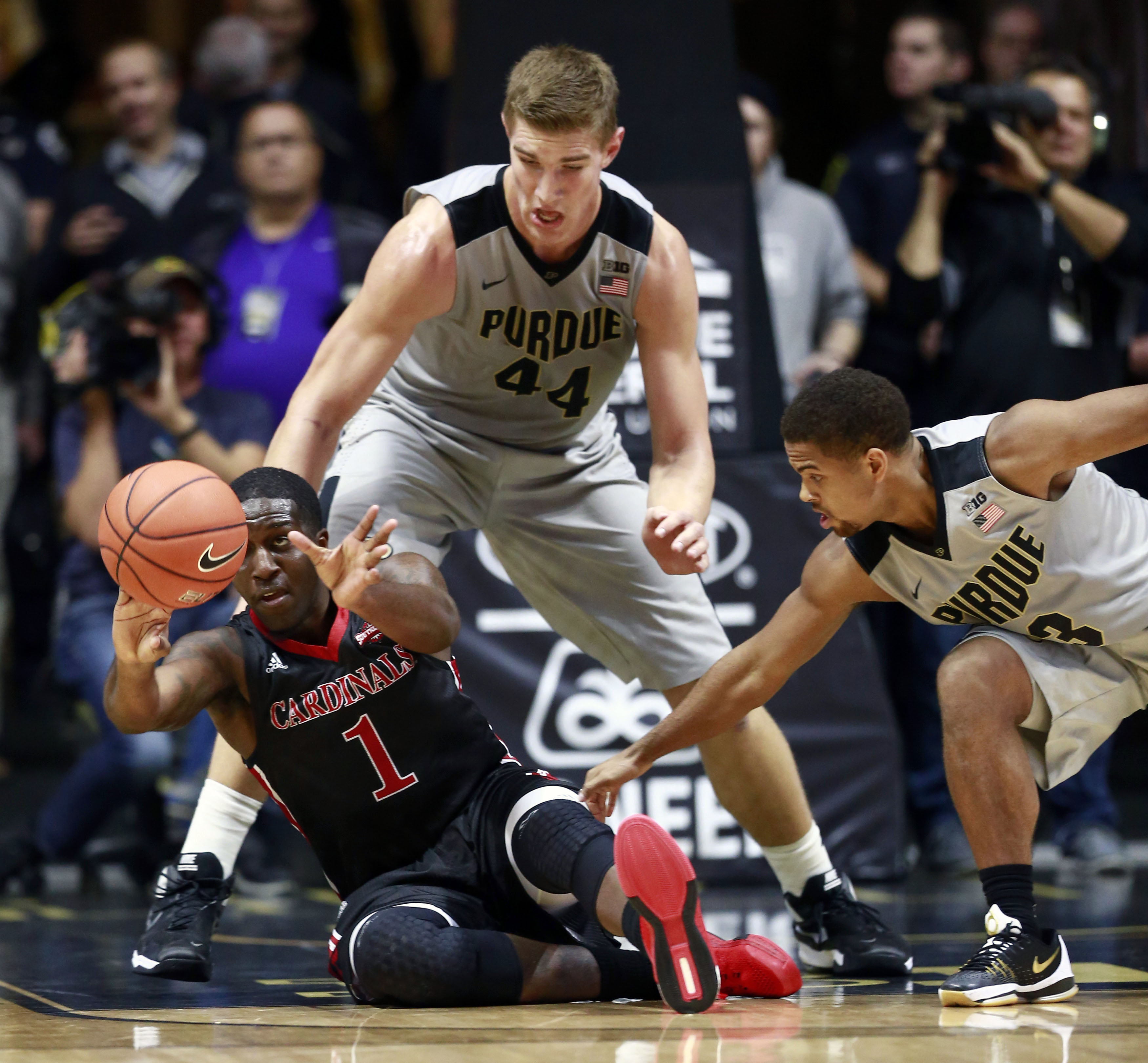 Incarnate Word forward Derail Green (1) passes the basketball while on the floor near Purdue center Isaac Haas (44) and guard P.J. Thompson in the first half of an NCAA college basketball game Wednesday, Nov. 18, 2015, in West Lafayette, Ind. Purdue won 9