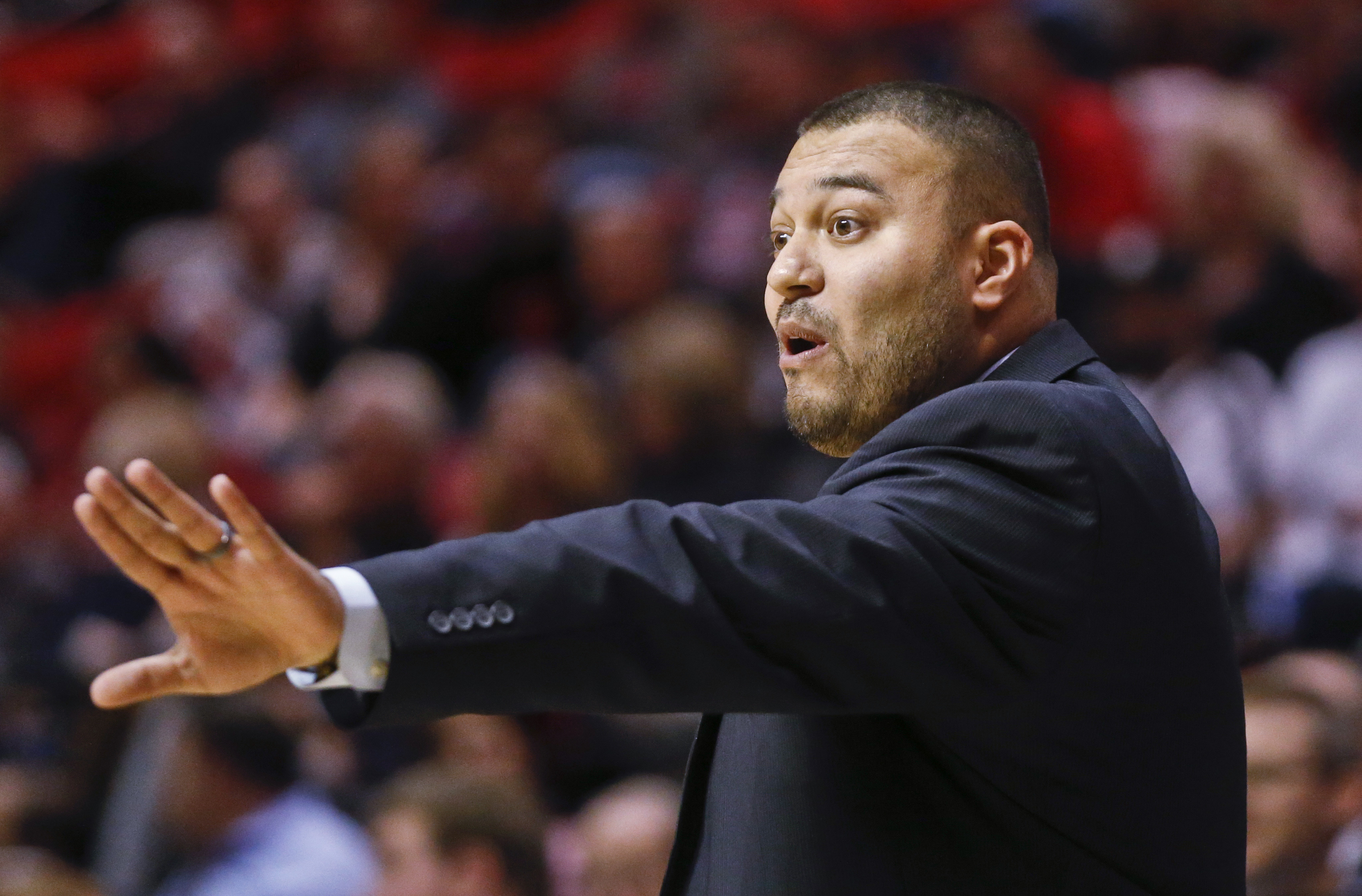 San Diego Christian coach Edgar Mendez reacts to a call in the first half of an NCAA college basketball game against the San Diego State, Wednesday, Nov. 18, 2015, in San Diego. (AP Photo/Lenny Ignelzi)
