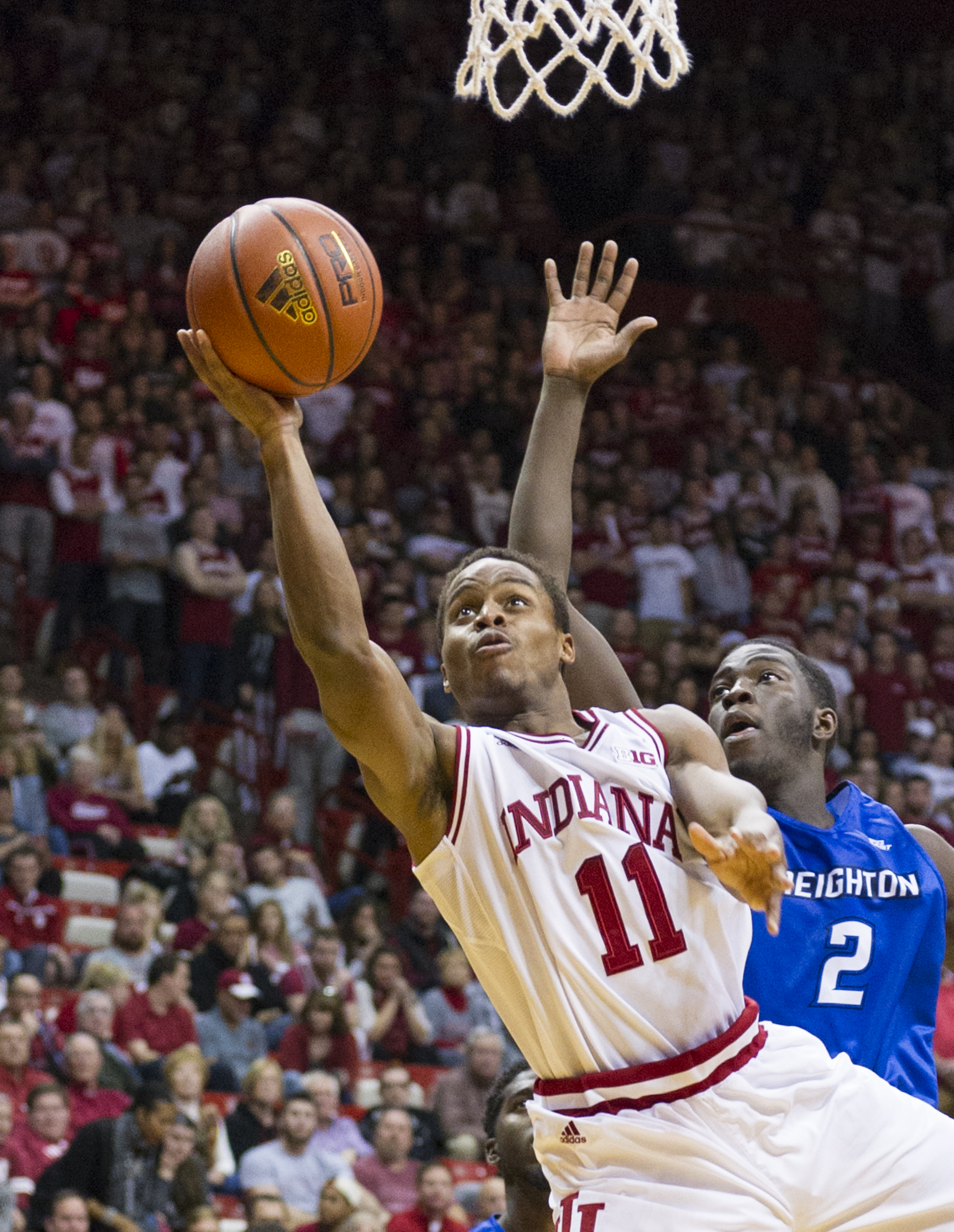 Indiana guard Yogi Ferrell (11) puts up a shot as he's defended by Creighton guard Khyri Thomas (2) during the second half of an NCAA college basketball game, Thursday, Nov. 19, 2015, in Bloomington, Ind. Indiana won 86-65. (AP Photo/Doug McSchooler)