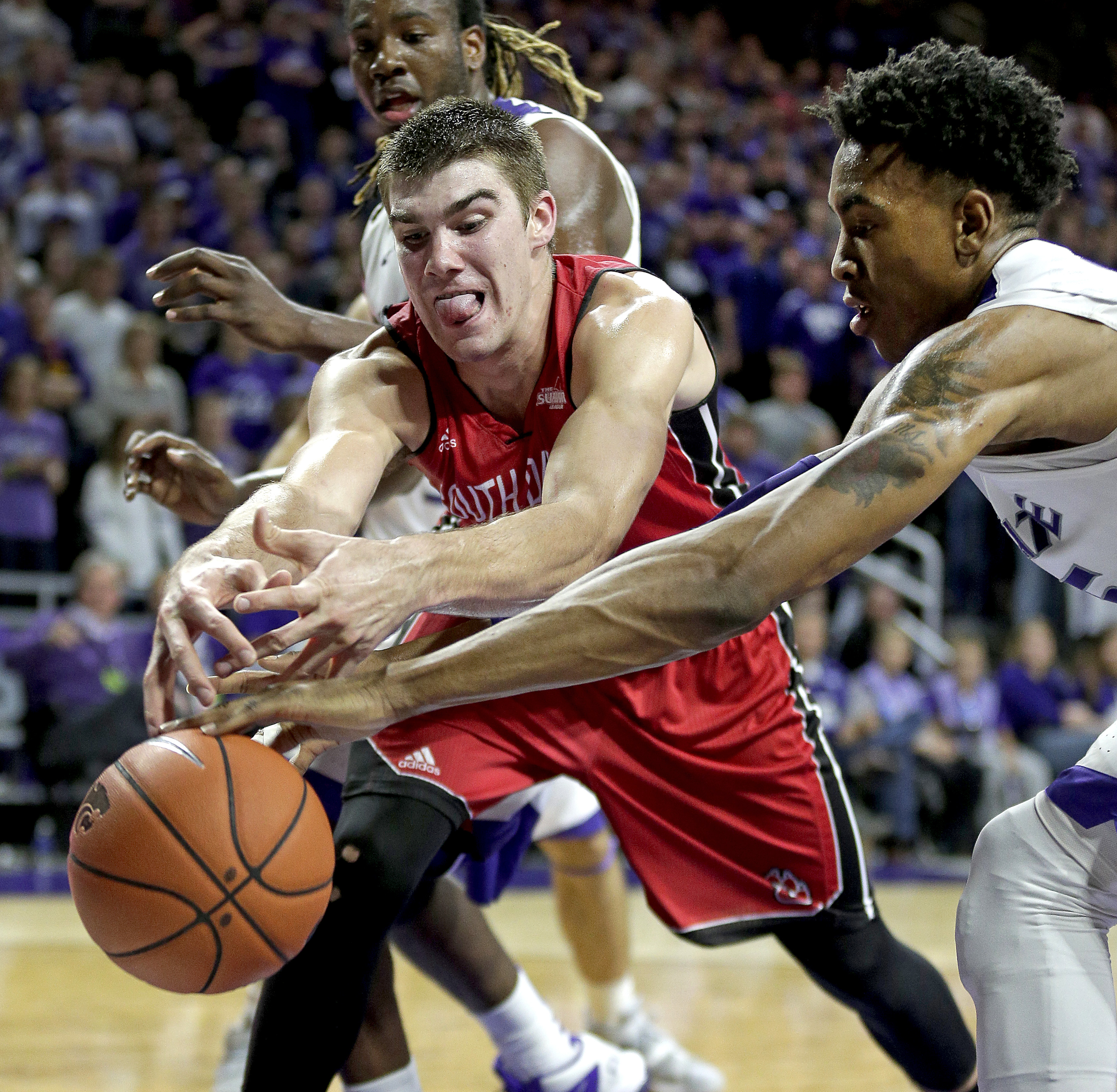 South Dakota's Dan Jech, left, and Kansas State's Wesley Iwundu chase a loose ball during the first half of an NCAA college basketball game Friday, Nov. 20, 2015, in Manhattan, Kan. (AP Photo/Charlie Riedel)