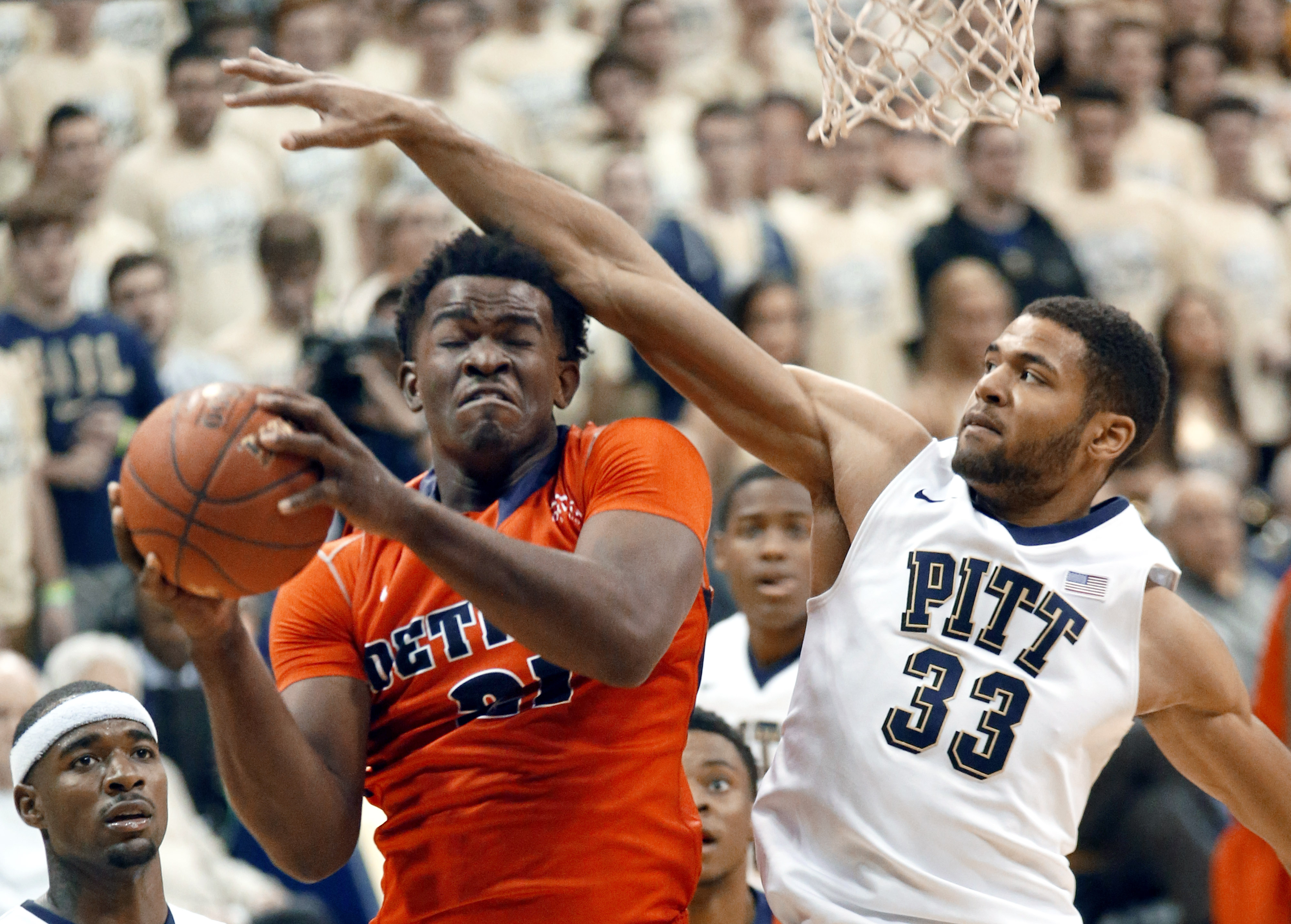 Detroit's Jaleel Hogan (21) is fouled by Pittsburgh's Alonzo Nelson-Ododa (33) during the second half of an NCAA college basketball game Friday, Nov. 20, 2015, in Pittsburgh. (AP Photo/Keith Srakocic)