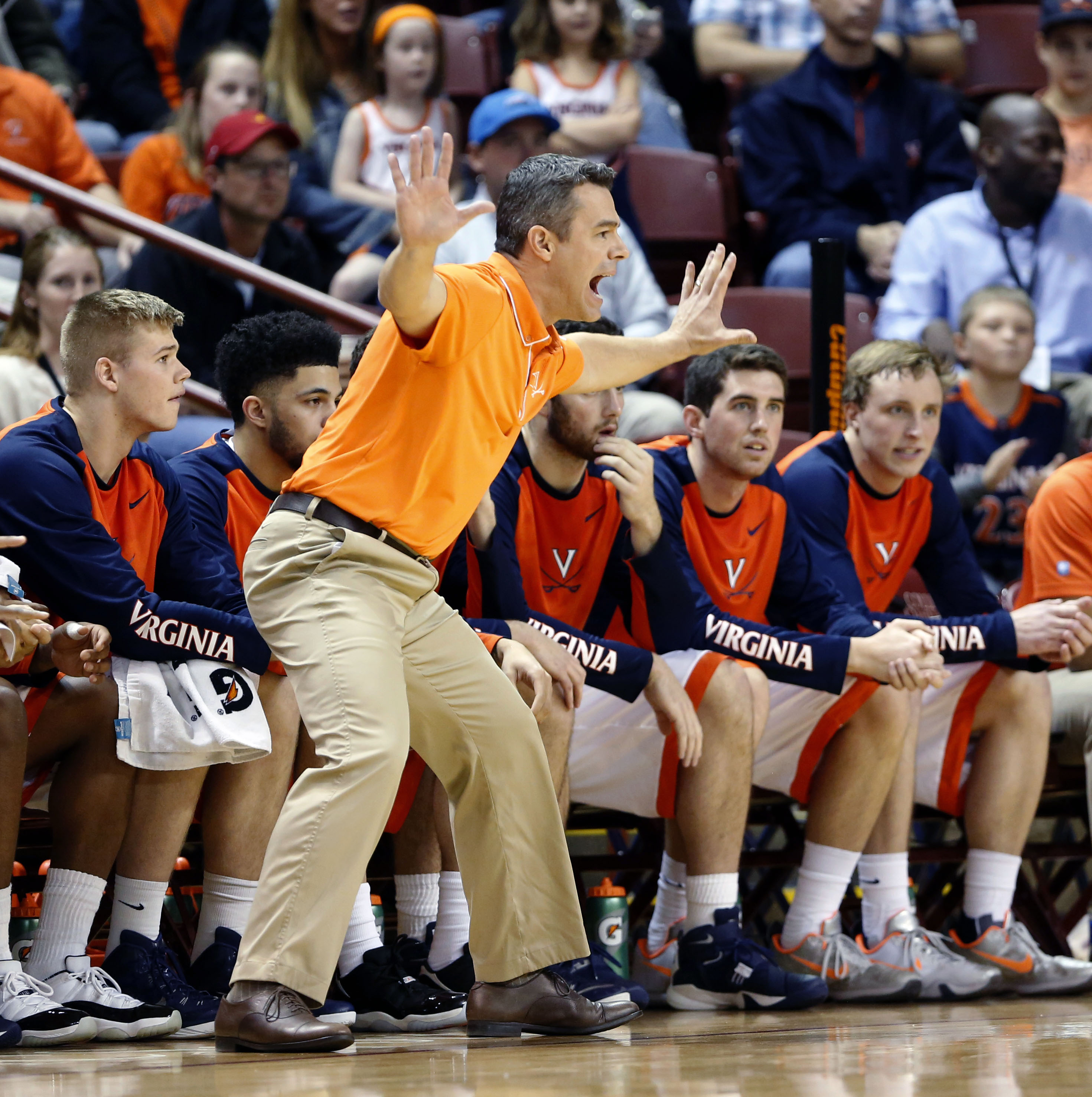 Virginia's head coach Tony Bennett yells out directions during their game against Long Beach State during the first half in an NCAA college basketball game at the Charleston Classic at TD Arena, Friday Nov. 20, 2015, in Charleston, S.C.  (AP Photo/Mic Smi