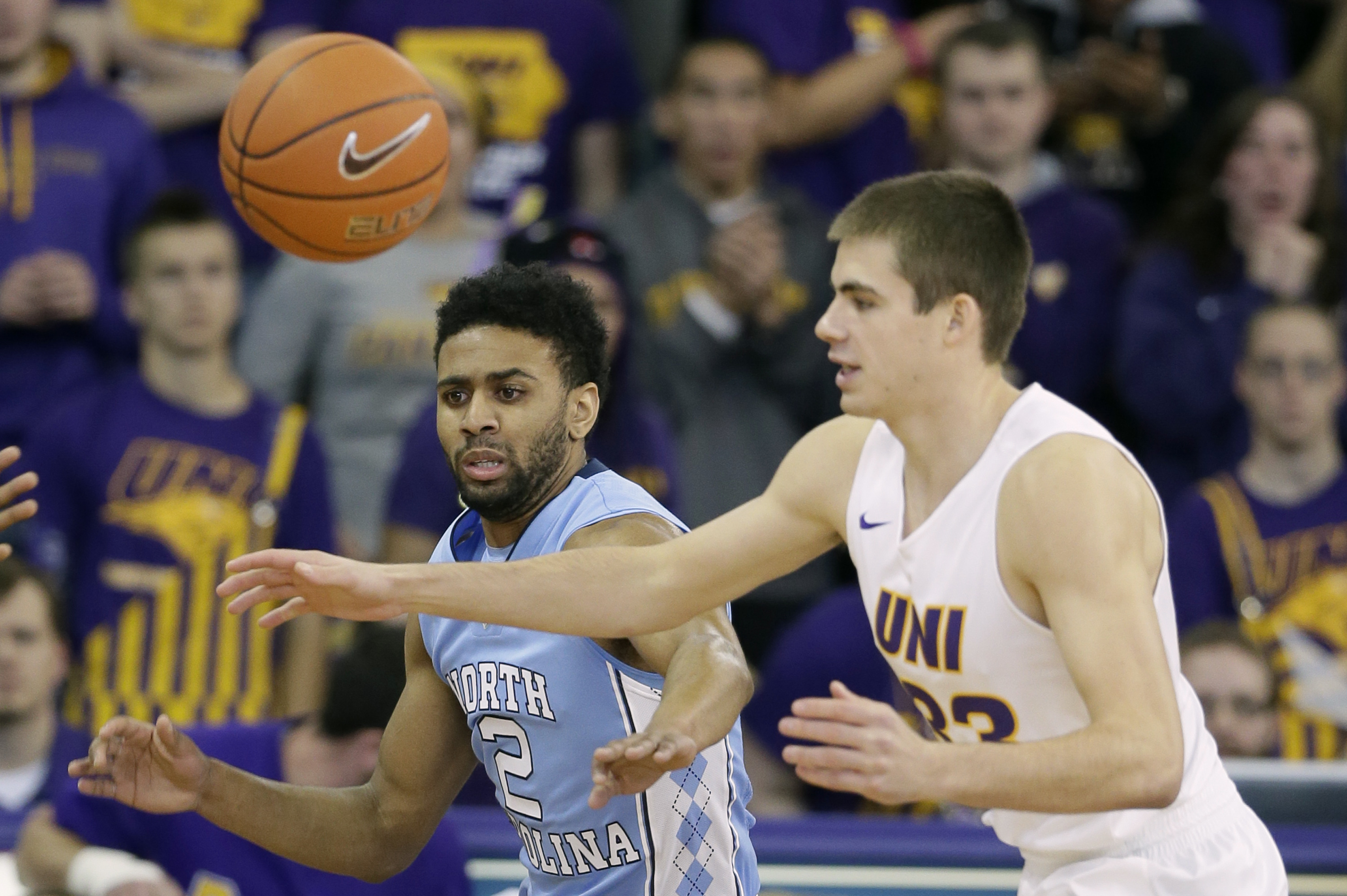 North Carolina guard Joel Berry II, left, tries to steal the ball from Northern Iowa guard Wyatt Lohaus, right, during the first half of an NCAA college basketball game, Saturday, Nov. 21, 2015, in Cedar Falls, Iowa. (AP Photo/Charlie Neibergall)