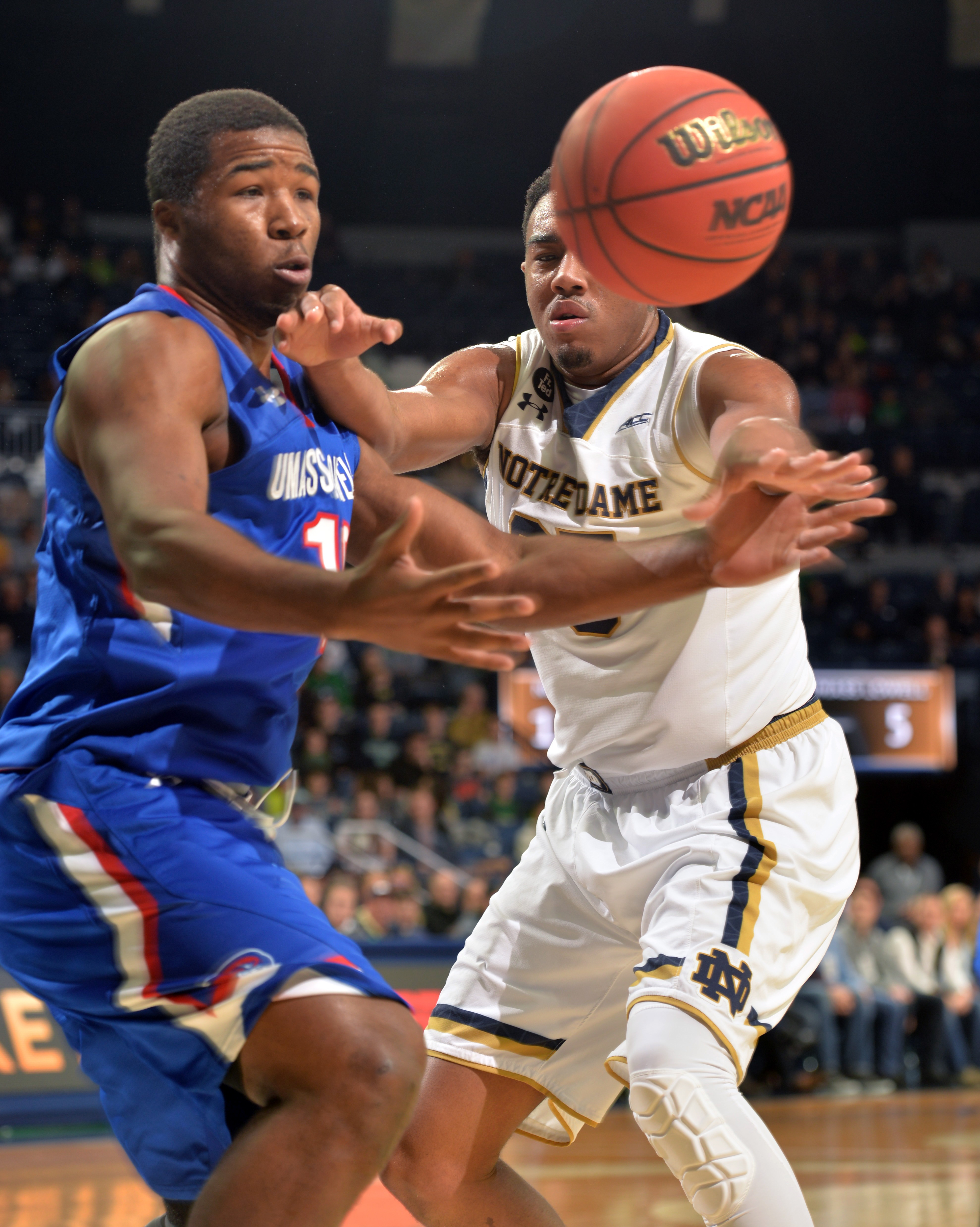 Notre Dame forward Bonzie Colson, right and U Mass Lowell Jahad Thomas reach for a loose ball during first half action in an NCAA college basketball game, Saturday Nov. 21, 2015 in South Bend, Ind. (AP Photo/Joe Raymond)
