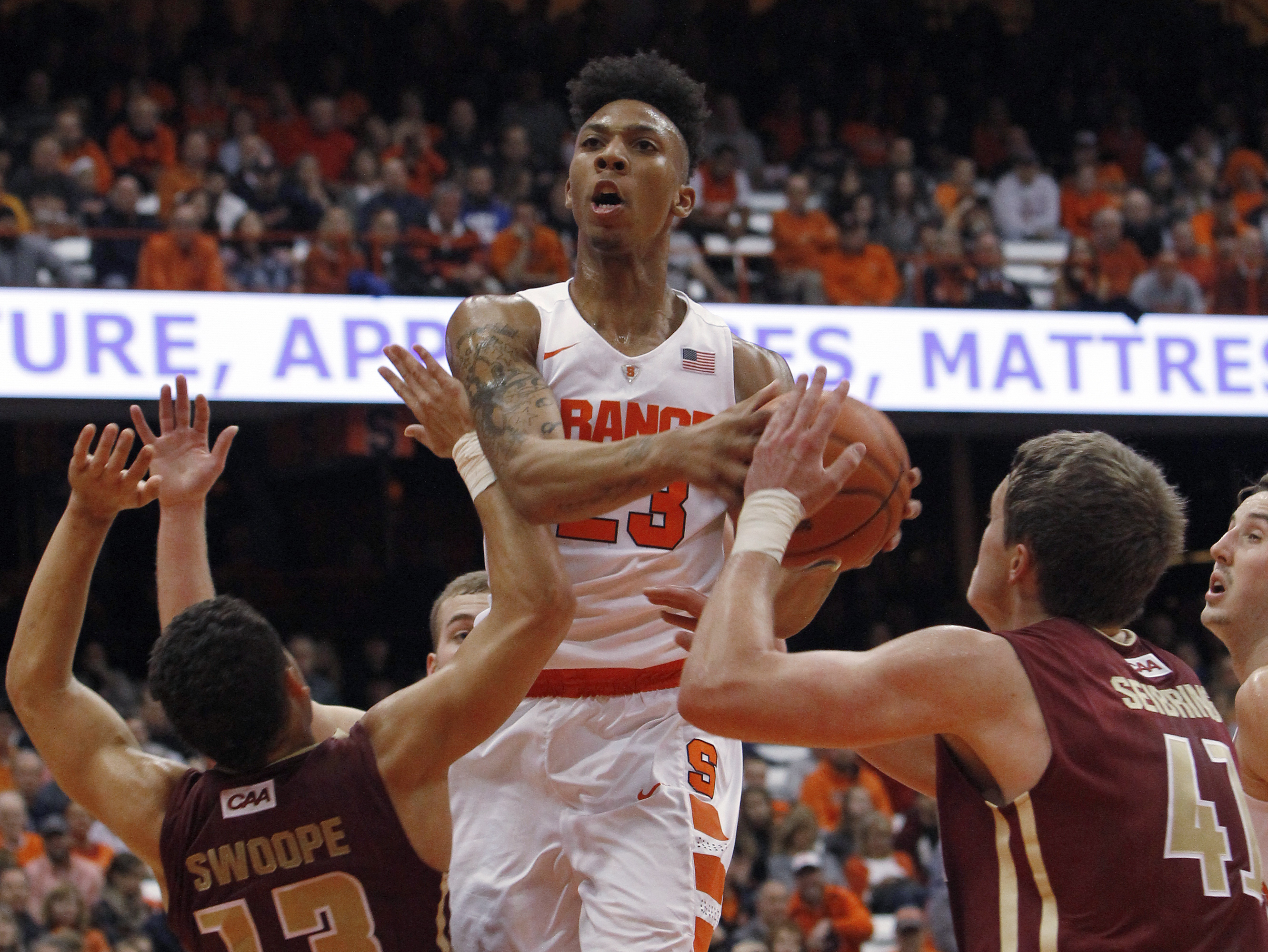 Syracuse's Malachi Richardson, center, looks to the basket between Elon's Dainan Swoope, left, and Tyler Seibring during the second half of an NCAA college basketball game in Syracuse, N.Y., Saturday, Nov. 21, 2015. Syracuse won 66-55. (AP Photo/Nick Lisi