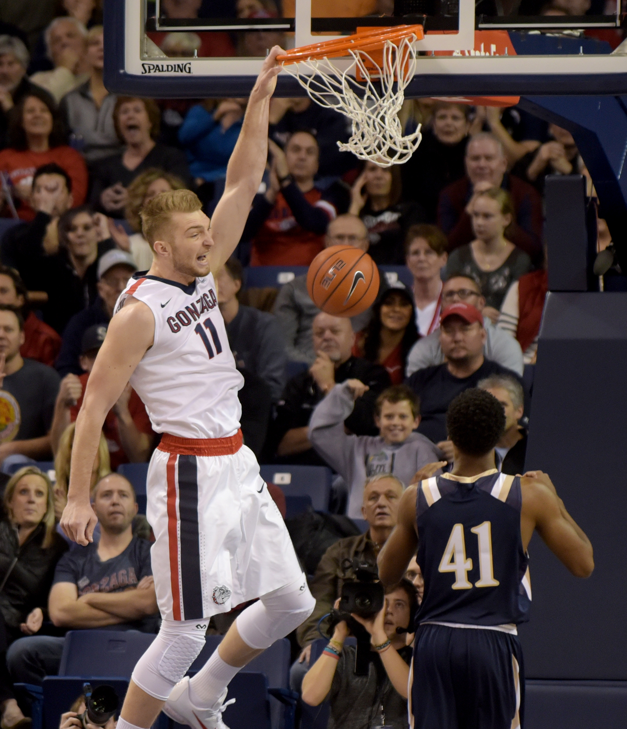 Gonzaga's Domantas Sabonis (11) dunks on Mount St. Mary's BK Ashe (41) in the first half of an NCAA college basketball game, Saturday, Nov. 21, 2015, in Spokane, Wash. Gonzaga beat Mount St. Mary's 101-56.(AP Photo/Rajah Bose)