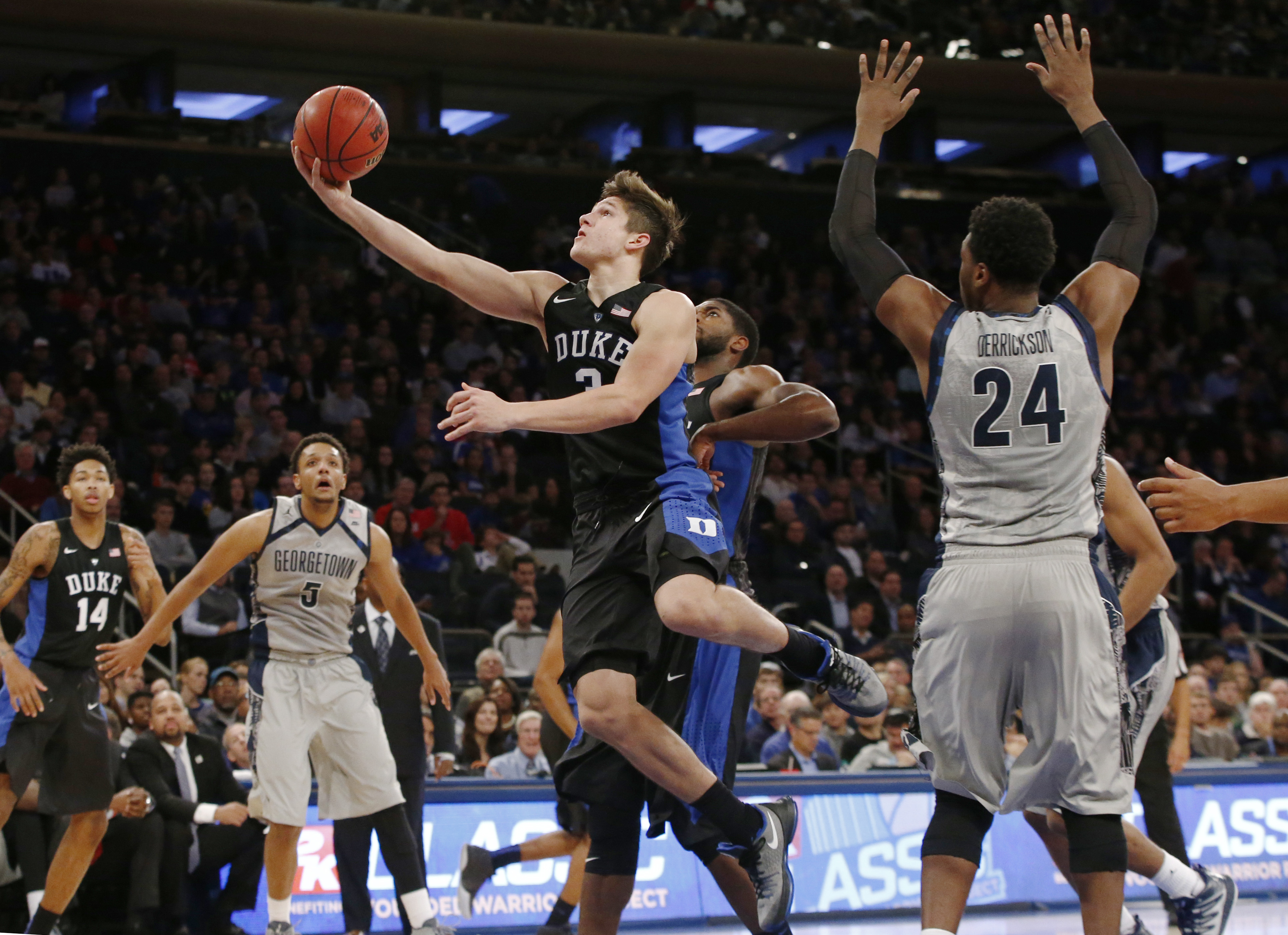 Duke guard Grayson Allen (3) goes up for a layup as Georgetown forward Reggie Cameron (5) watches from the floor in the first half of an NCAA college basketball game at Madison Square Garden in New York, Sunday, Nov. 22, 2015. (AP Photo/Kathy Willens)