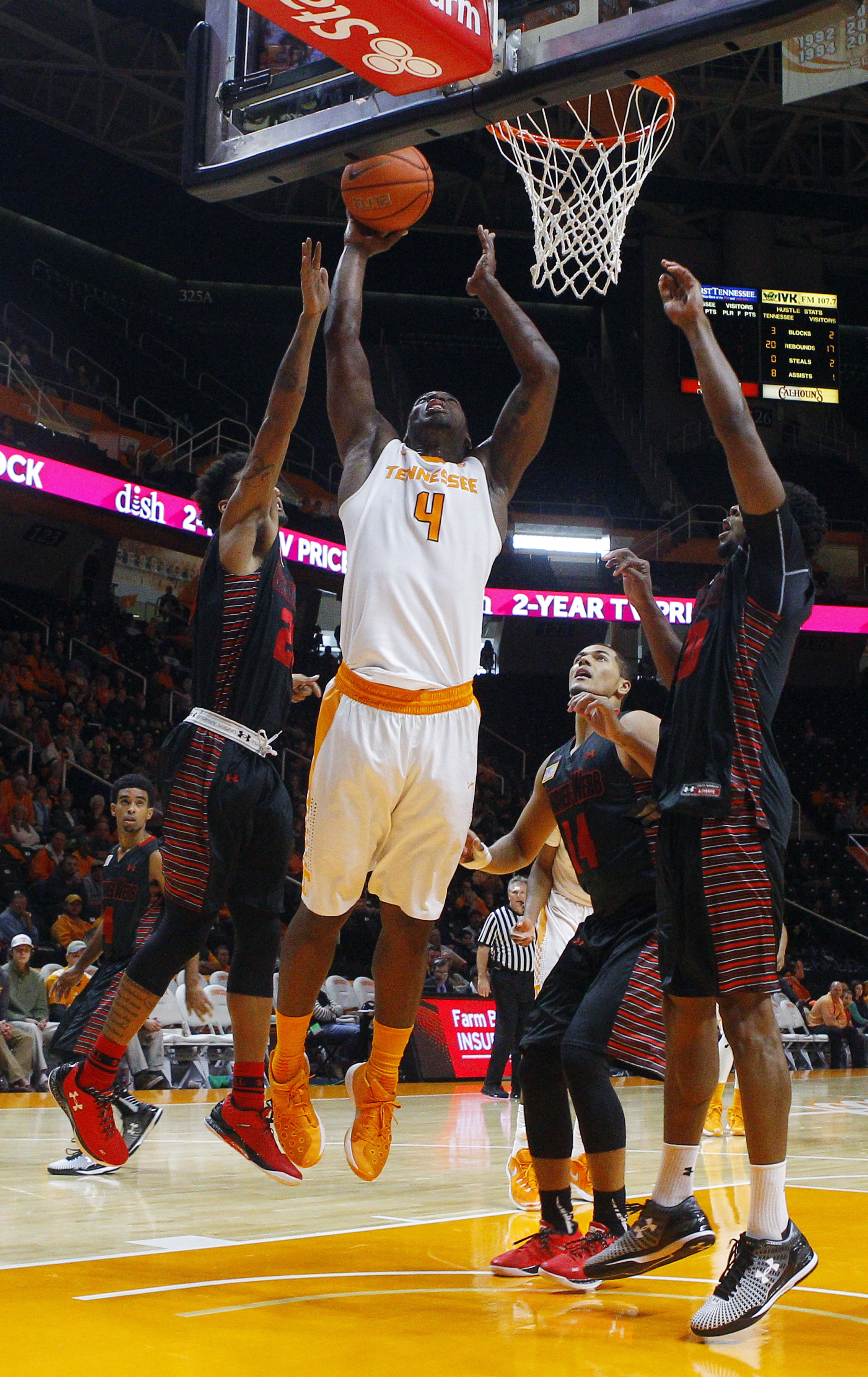 Tennessee forward Armani Moore (4) shoots between Gardner-Webb guard Eric Jamison (2), forward Brandon Miller (14) and guard Jamaal Robateau (0) during an NCAA college basketball game Sunday, Nov. 22, 2015. (Wade Payne/Knoxville News Sentinel via AP)