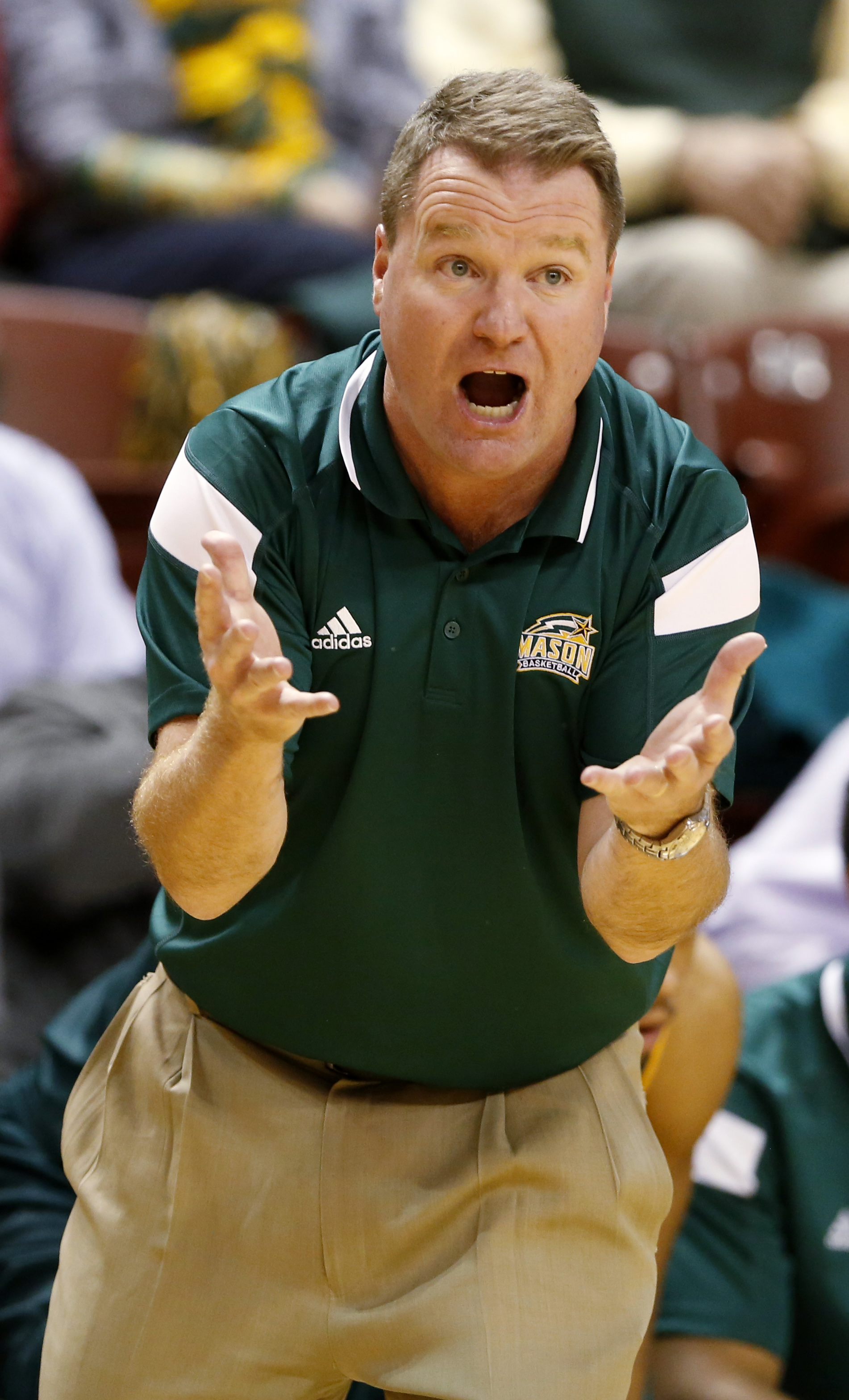 George Mason coach Dave Paulsen shouts to his players during the first half against Virginia in an NCAA college basketball game at the Charleston Classic, Sunday Nov. 22, 2015, in Charleston, S.C. (AP Photo/Mic Smith)