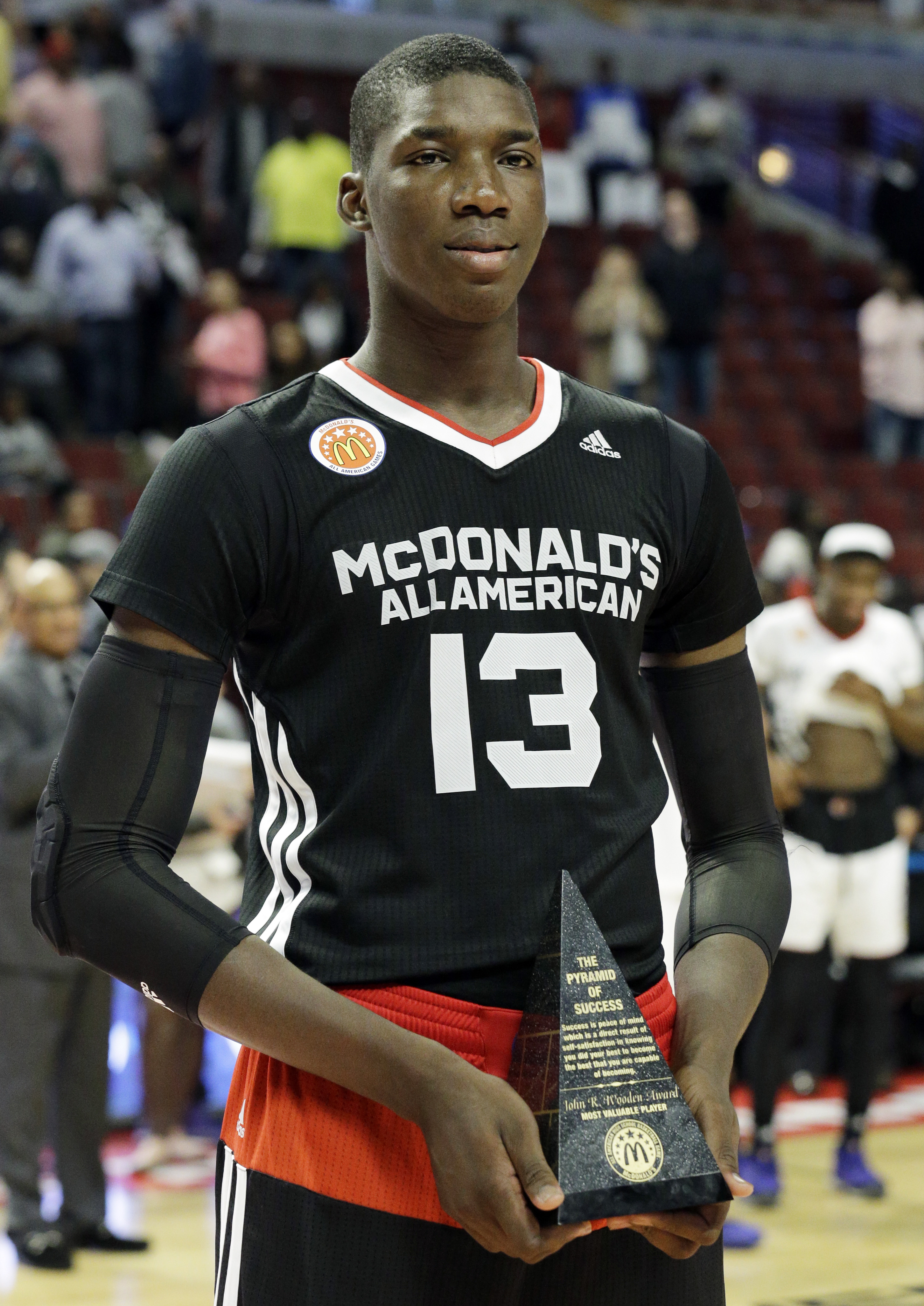 FILE - In this April 1, 2015, file photo, East forward Cheick Diallo of Our Savior New American in Centereach, N.Y., holds the MVP trophy after East defeated West 111-91 in the McDonald's All-American boys basketball game in Chicago. Kansas officials have