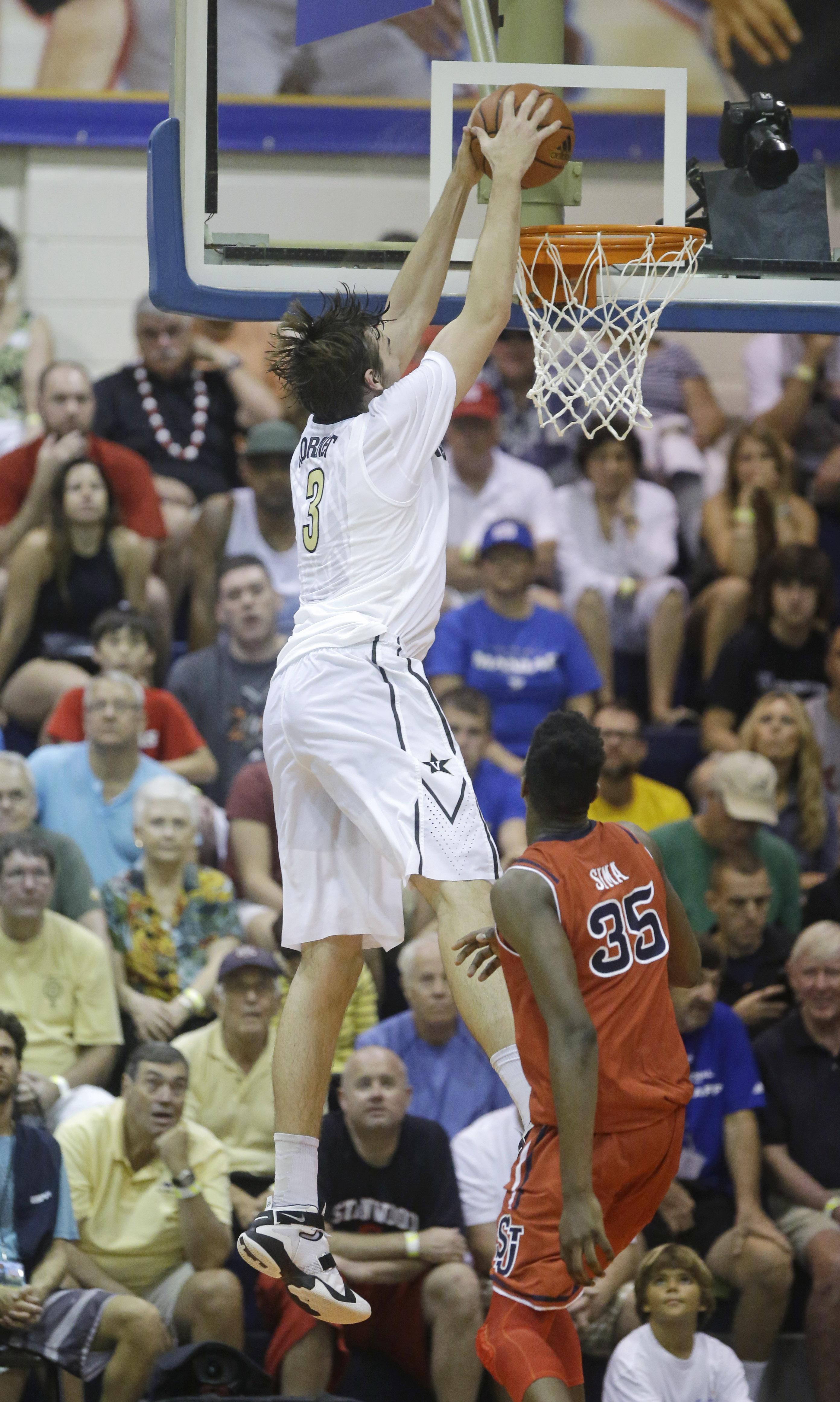 Vanderbilt forward Luke Kornet (3) dunks the ball against St. John's center Yankuba Sima (35) in the first half during an NCAA college basketball game in the first round of the Maui Invitational Monday, Nov. 23, 2015, in Lahaina, Hawaii. (AP Photo/Rick Bo