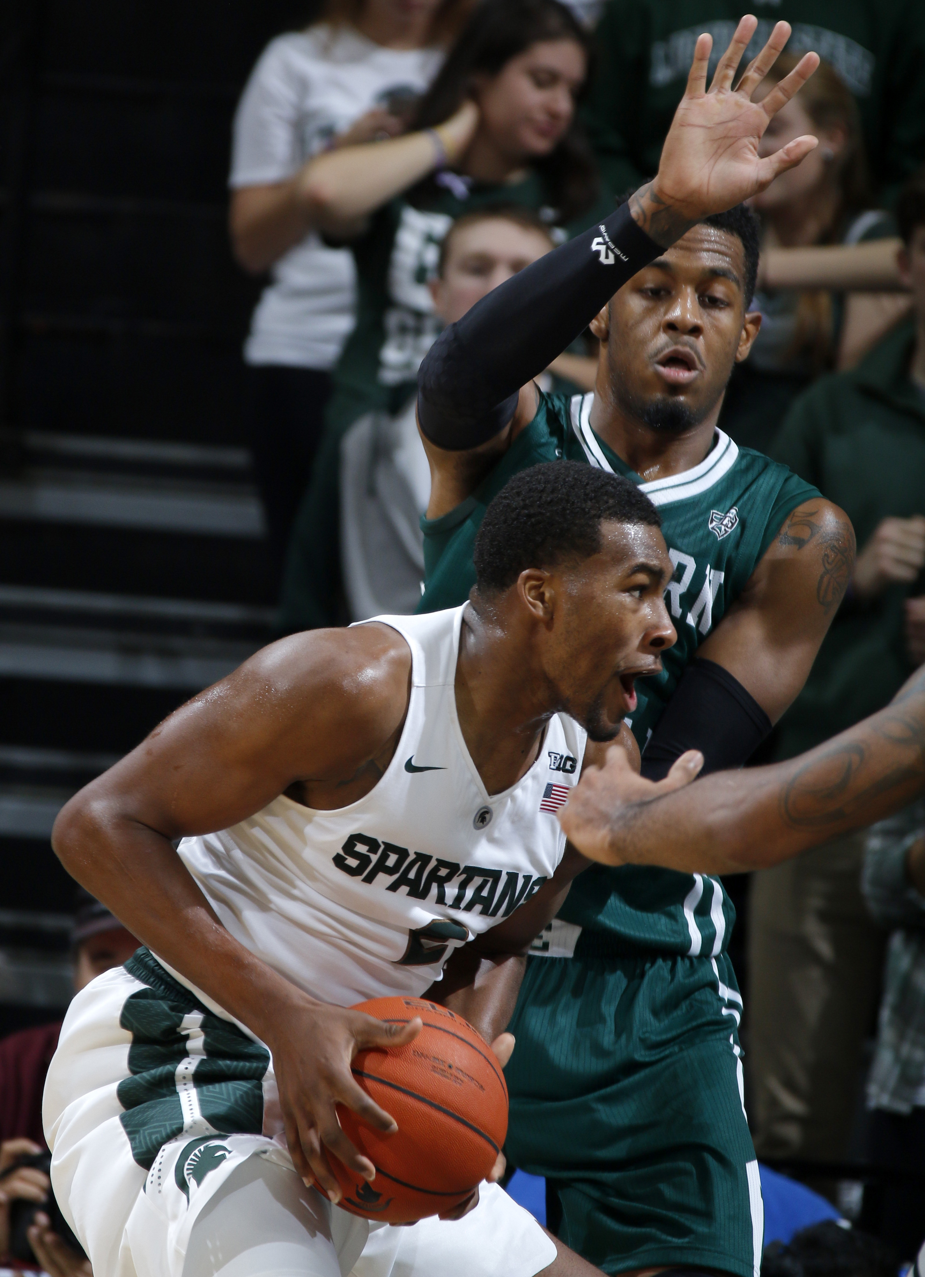 Michigan State's Javon Bess, left, maneuvers for a shot against Eastern Michigan's James Thompson during the first half of an NCAA college basketball game, Monday, Nov. 23, 2015, in East Lansing, Mich. (AP Photo/Al Goldis)