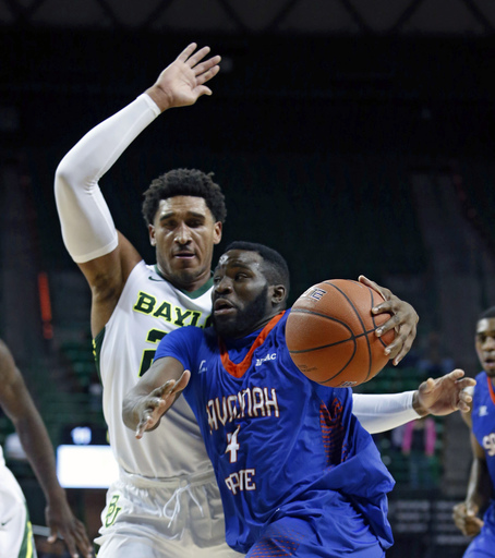 Savannah State guard Troyce Manassa (4) drives on Baylor guard Ishmail Wainright (24), left, during the first half of an NCAA college basketball game, Monday, Nov. 23, 2015, in Waco, Texas. (Jose Yau/Waco Tribune Herald, via AP) MANDATORY CREDIT