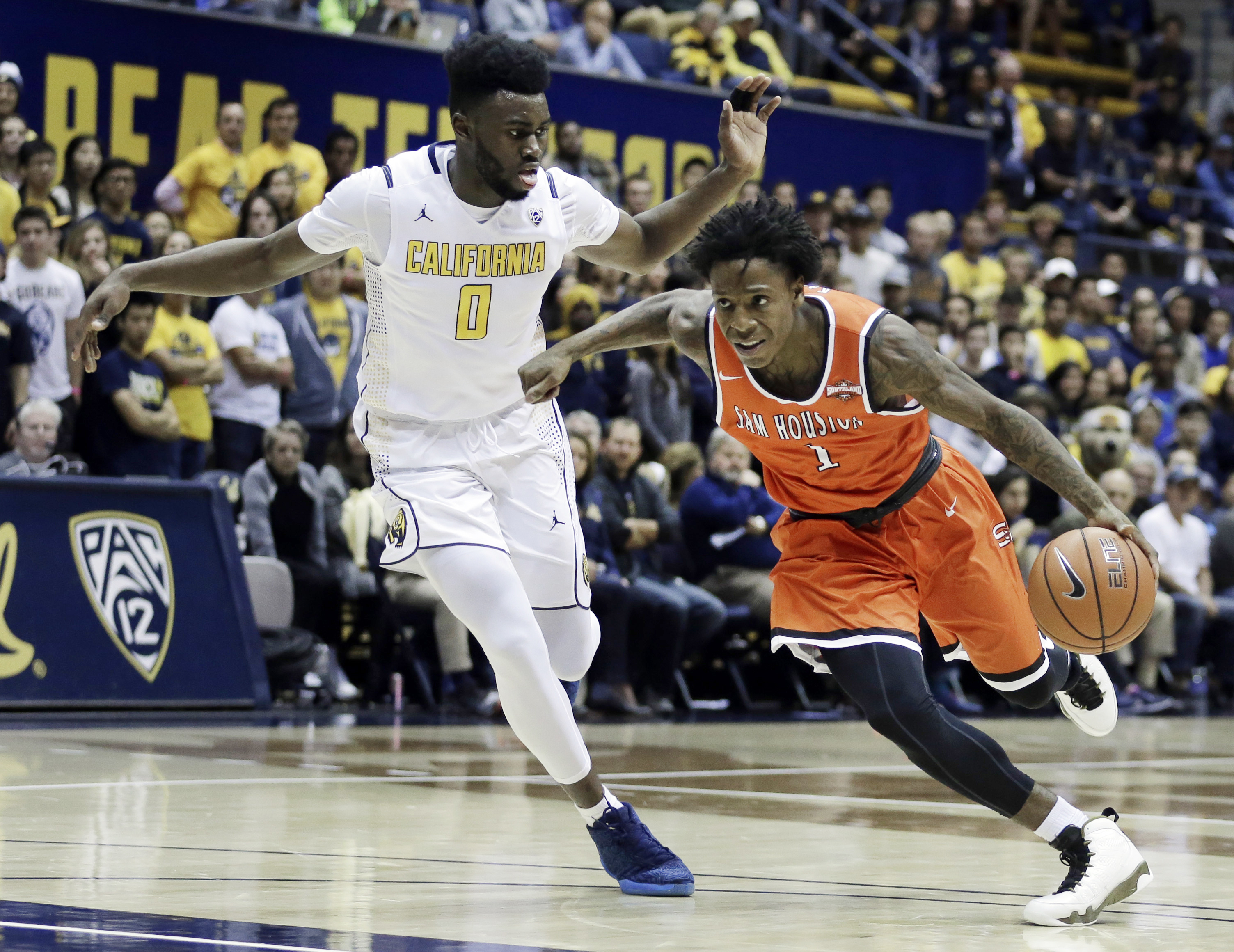 Sam Houston State's Ameer Jackson, right, drives the ball past California's Jaylen Brown (0) in the first half of an NCAA college basketball game Monday, Nov. 23, 2015, in Berkeley, Calif. (AP Photo/Ben Margot)