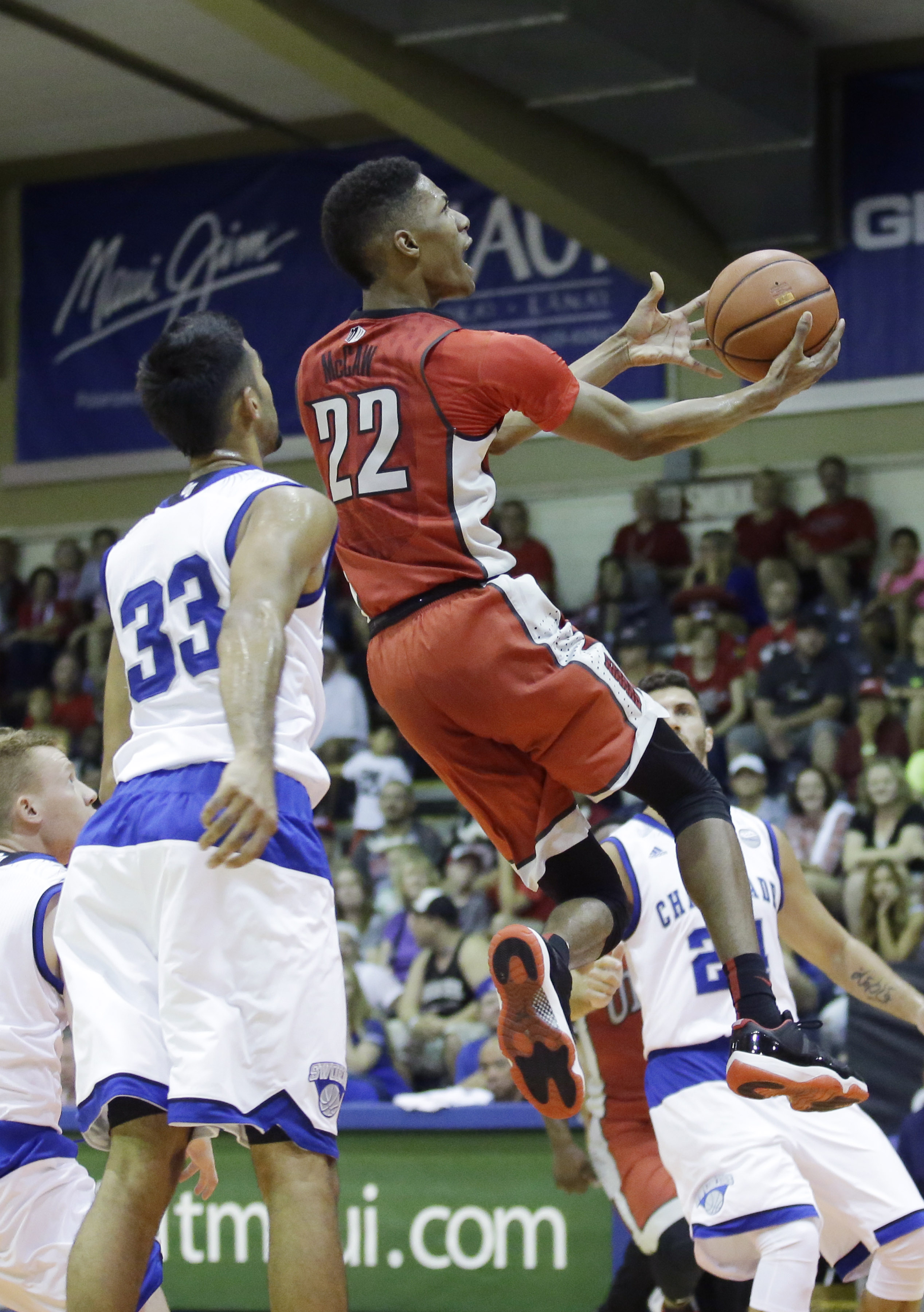 UNLV guard Patrick McCaw (22) goes to the basket as Chaminade guard Kiran Shastri (33) looks on in the first half during an NCAA college basketball game in the second round of the Maui Invitational Tournament, Tuesday, Nov. 24, 2015, in Lahaina, Hawaii.