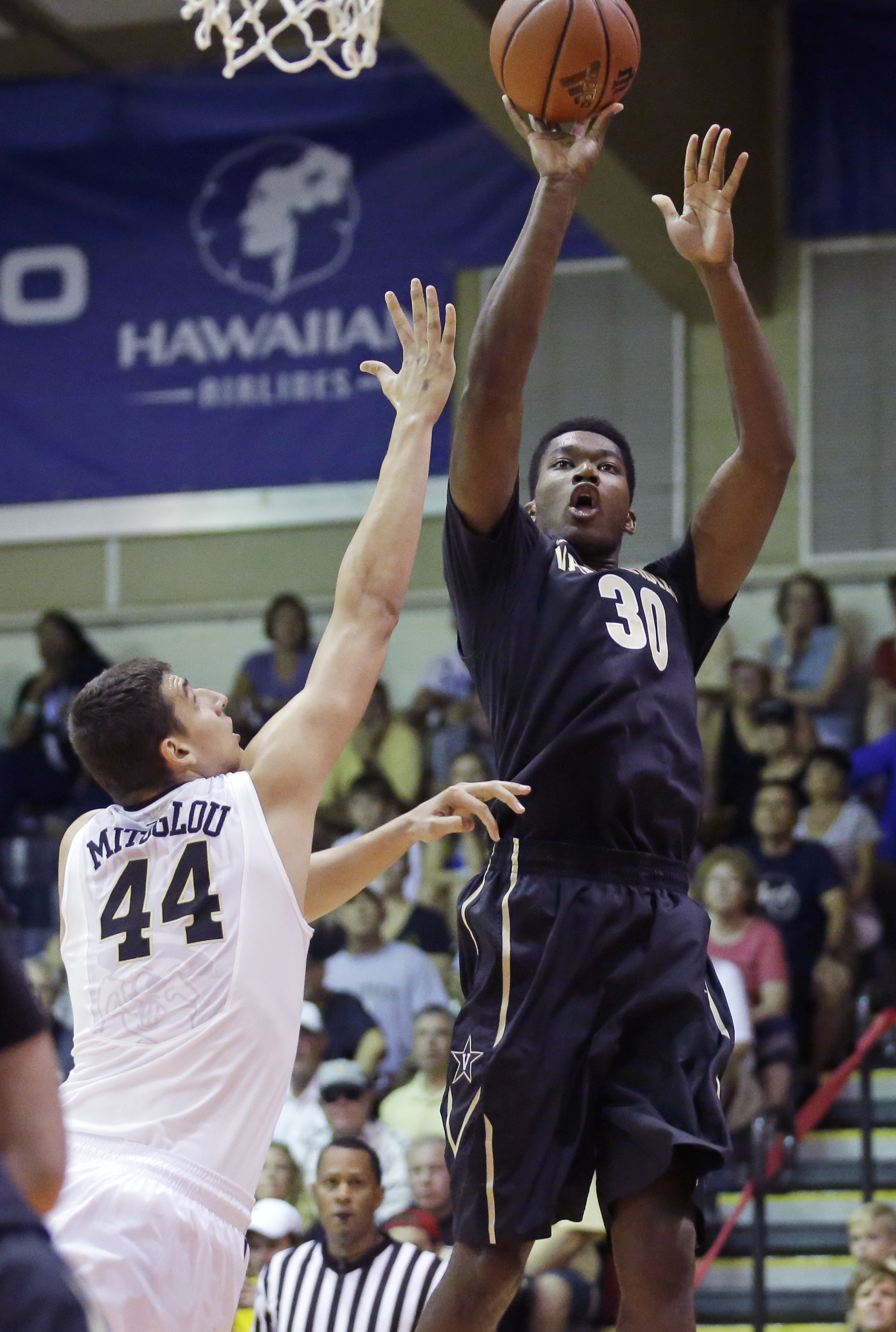 Vanderbilt center Damian Jones (30) shoots as Wake Forest forward Konstantinos Mitoglou (44) defends during the first half of an NCAA college basketball game in the second round of the Maui Invitational, Tuesday, Nov. 24, 2015, in Lahaina, Hawaii. (AP Pho