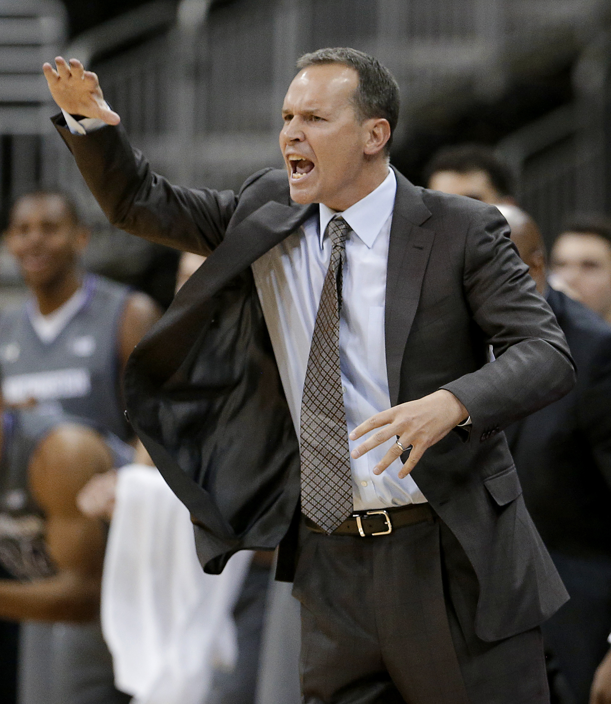 Northwestern coach Chris Collins talks to his players during the first half of an NCAA college basketball game against Missouri on Tuesday, Nov. 24, 2015, in Kansas City, Mo. (AP Photo/Charlie Riedel)