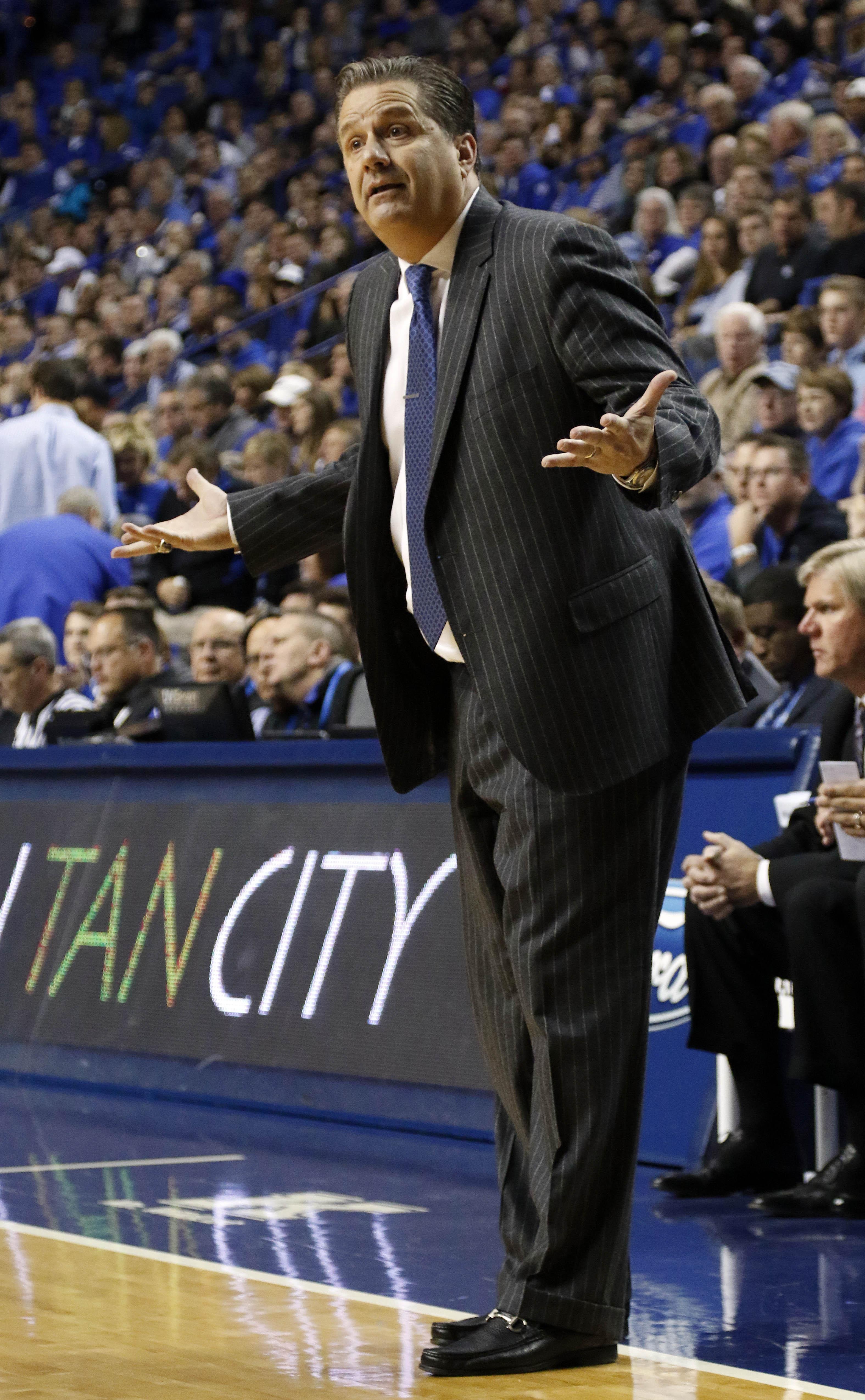 Kentucky head coach John Calipari questions a player during the second half of an NCAA college basketball game against Boston University Tuesday, Nov. 24, 2015, in Lexington, Ky. Kentucky won 82-62. (AP Photo/James Crisp)
