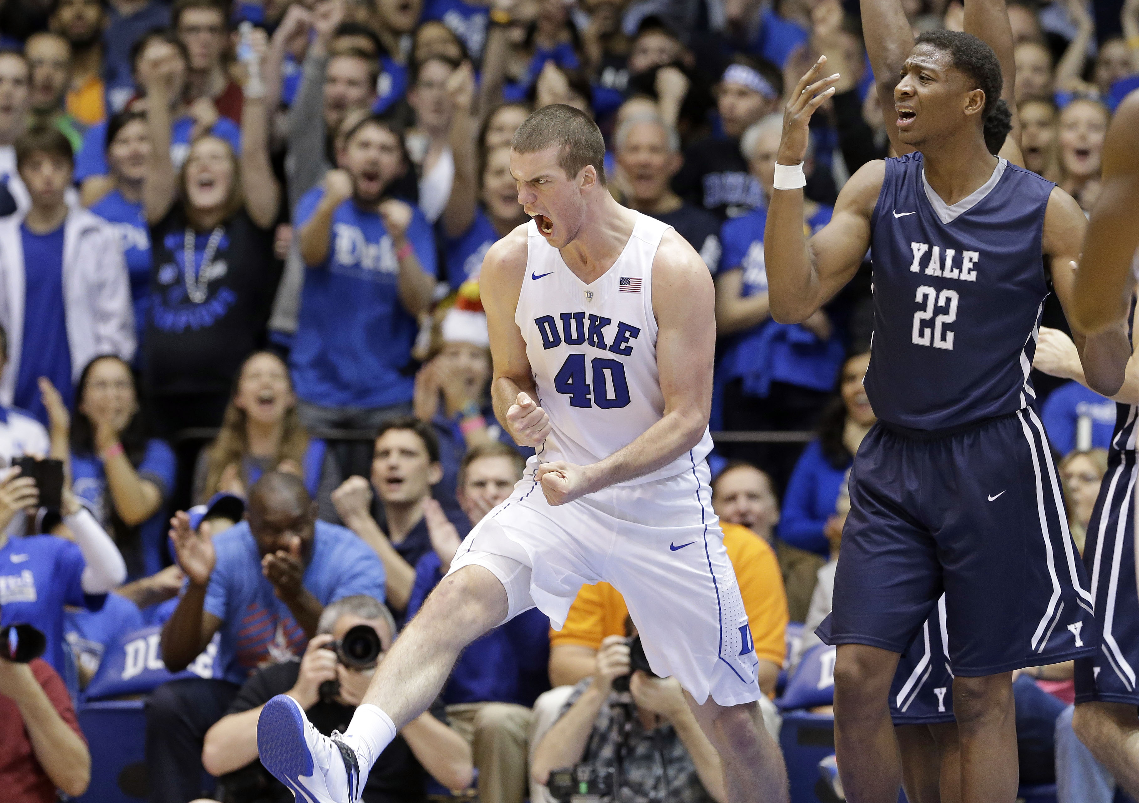 Duke's Marshall Plumlee (40) reacts following a basket, next to Yale's Justin Sears (22) during the second half of an NCAA college basketball game in Durham, N.C., Wednesday, Nov. 25, 2015. Duke won 80-61. (AP Photo/Gerry Broome)