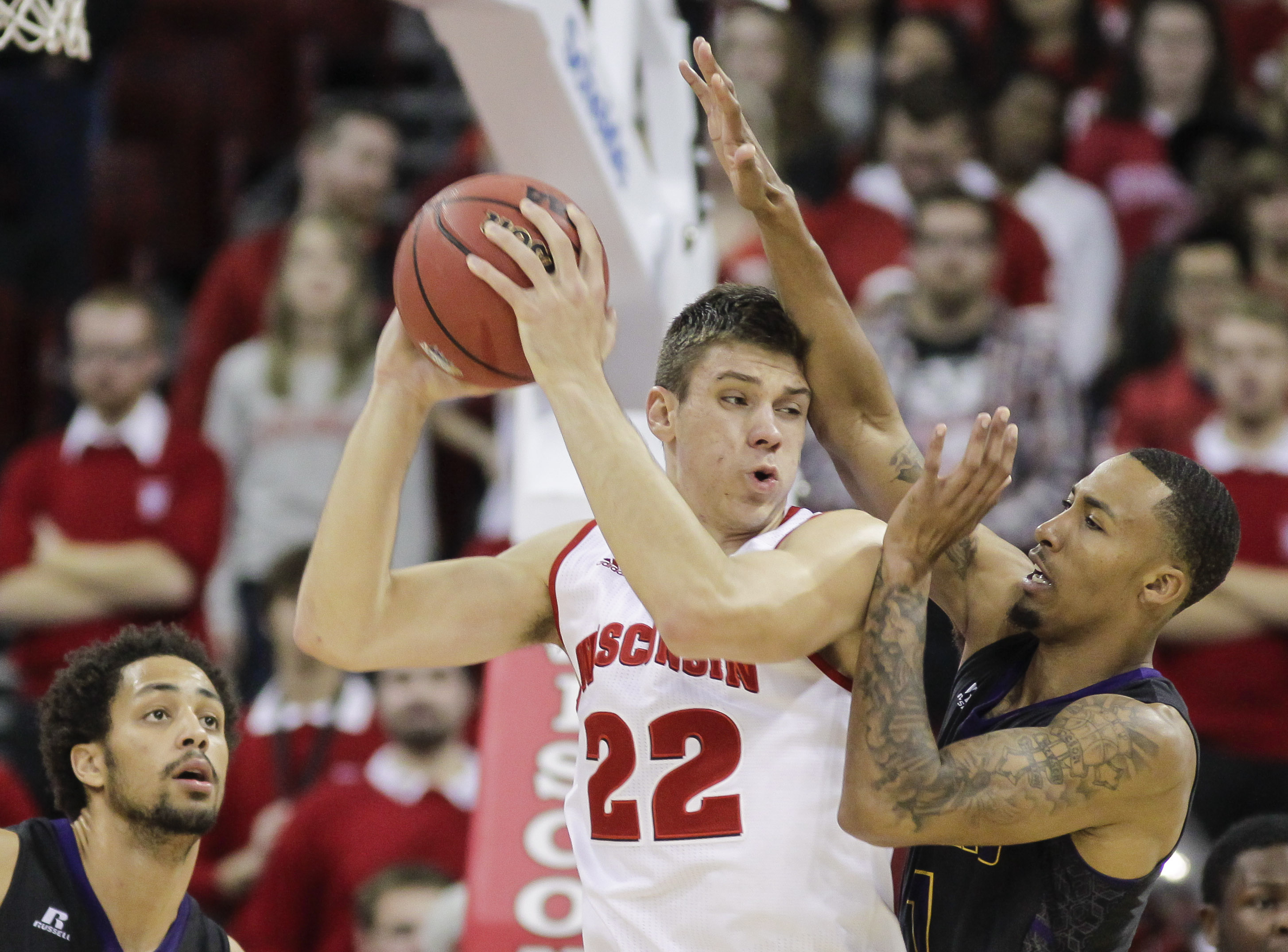 Wisconsin's Ethan Happ (22) keeps the ball from Prairie View A&M's Jayrn Johnson, right, during the first half of an NCAA college basketball game Wednesday Nov. 25, 2015, in Madison, Wis. (AP Photo/Andy Manis)