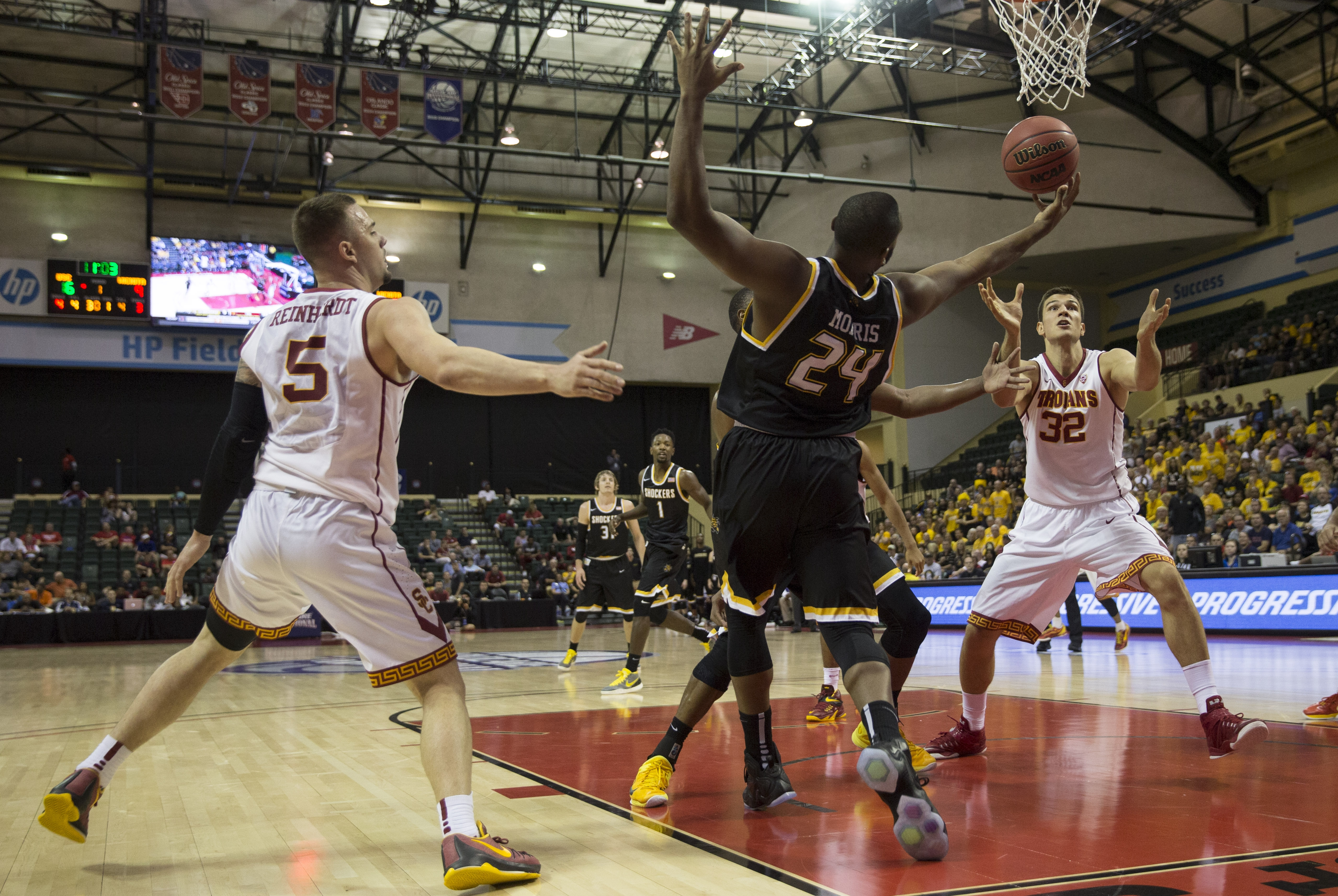 Wichita State forward Shaquille Morris (24), USC guard Katin Reinhardt (5) and forward Nikola Jovanovic (32) all vie for the ball during the first half of the Advocare Invitational college basketball game Thursday, Nov. 26, 2015, in Orlando, Fla.   (AP Ph