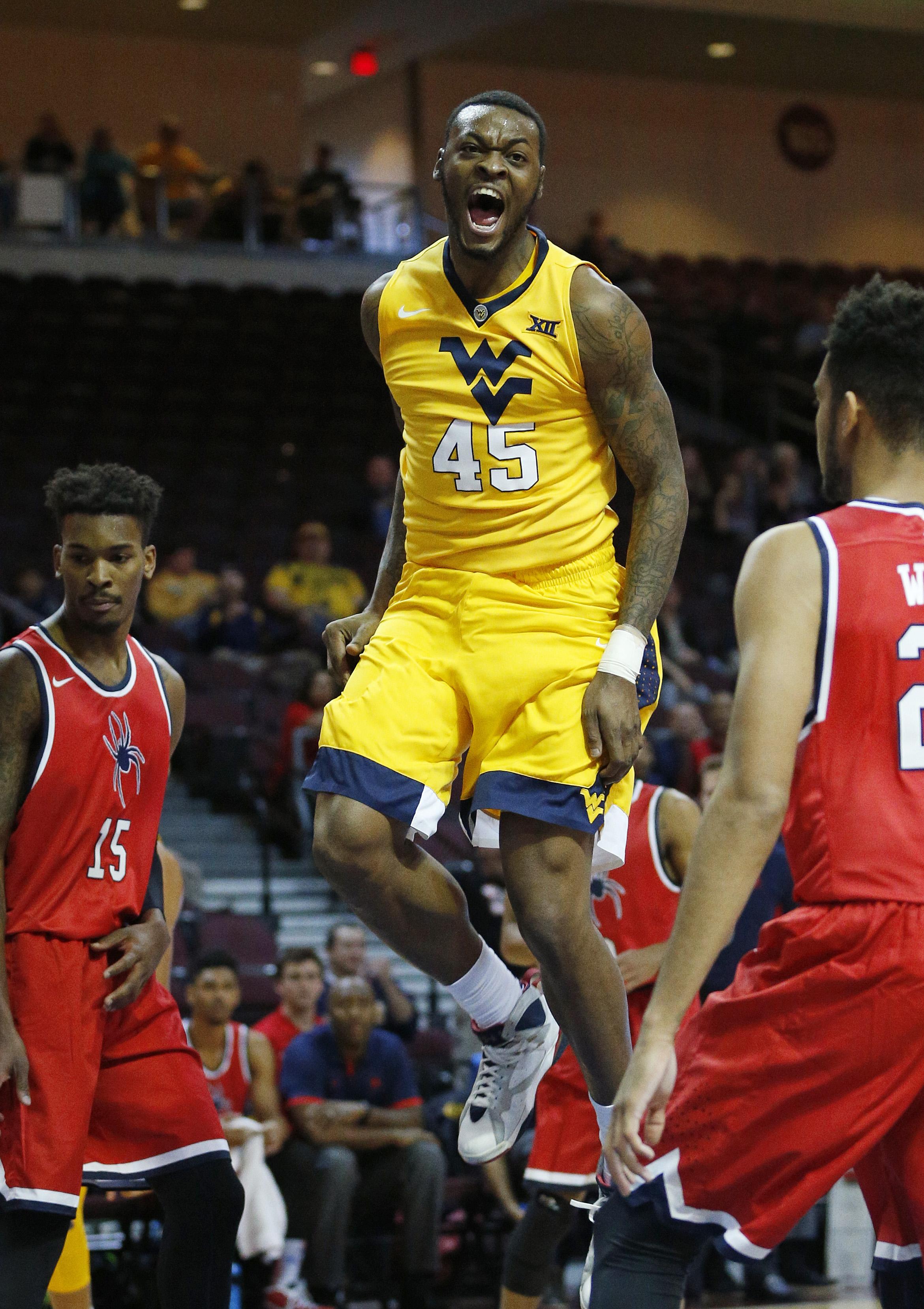 West Virginia forward Elijah Macon celebrates after scoring against Richmond during the first half of an NCAA college basketball game Thursday, Nov. 26, 2015, in Las Vegas. (AP Photo/John Locher)