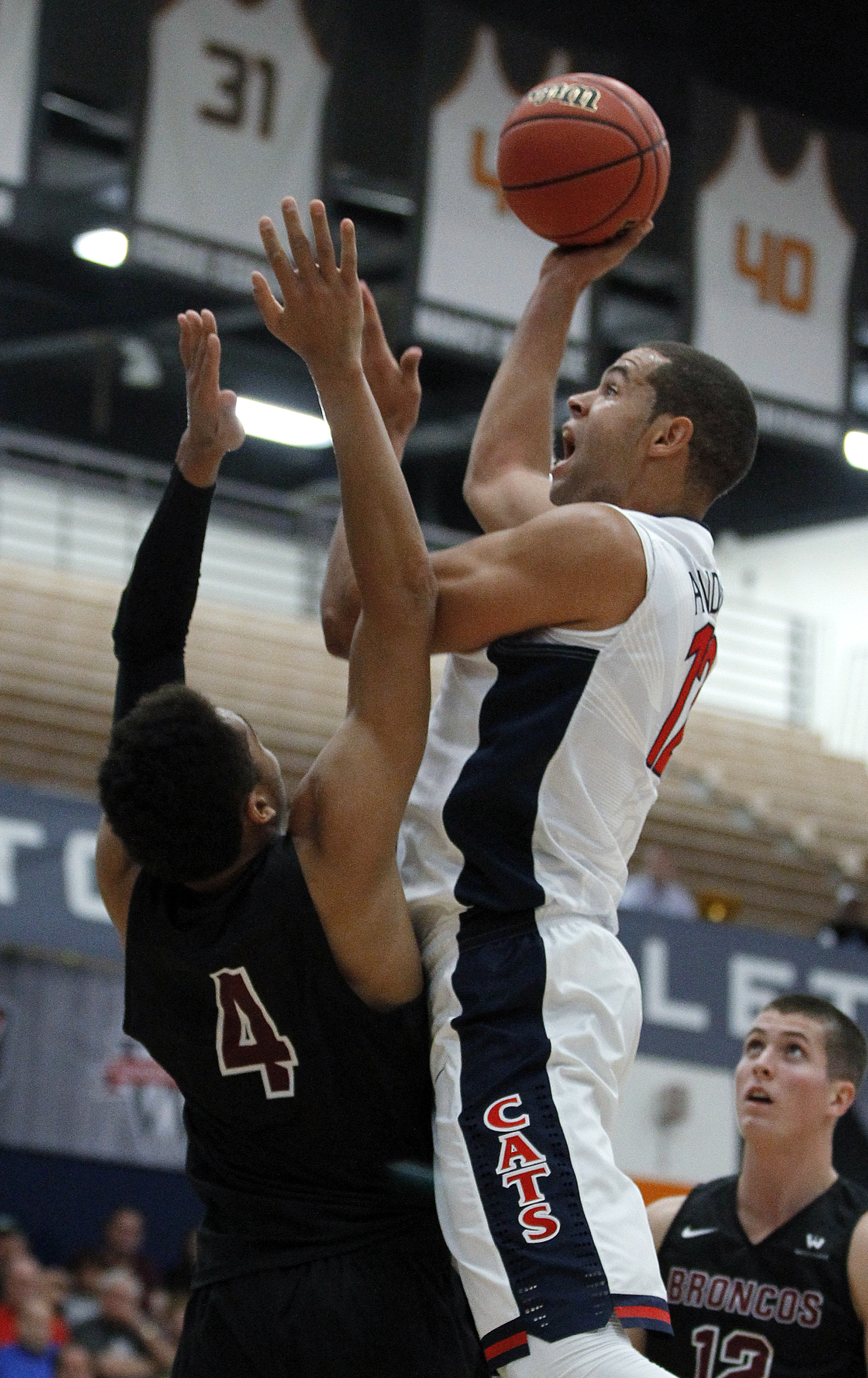 Arizona forward Ryan Anderson shoots over Santa Clara guard Jarvis Pugh during the first half of an NCAA college basketball game in the quarterfinals of the Wooden Legacy tournament in Fullerton, Calif., Thursday, Nov. 26, 2015. (AP Photo/Alex Gallardo)