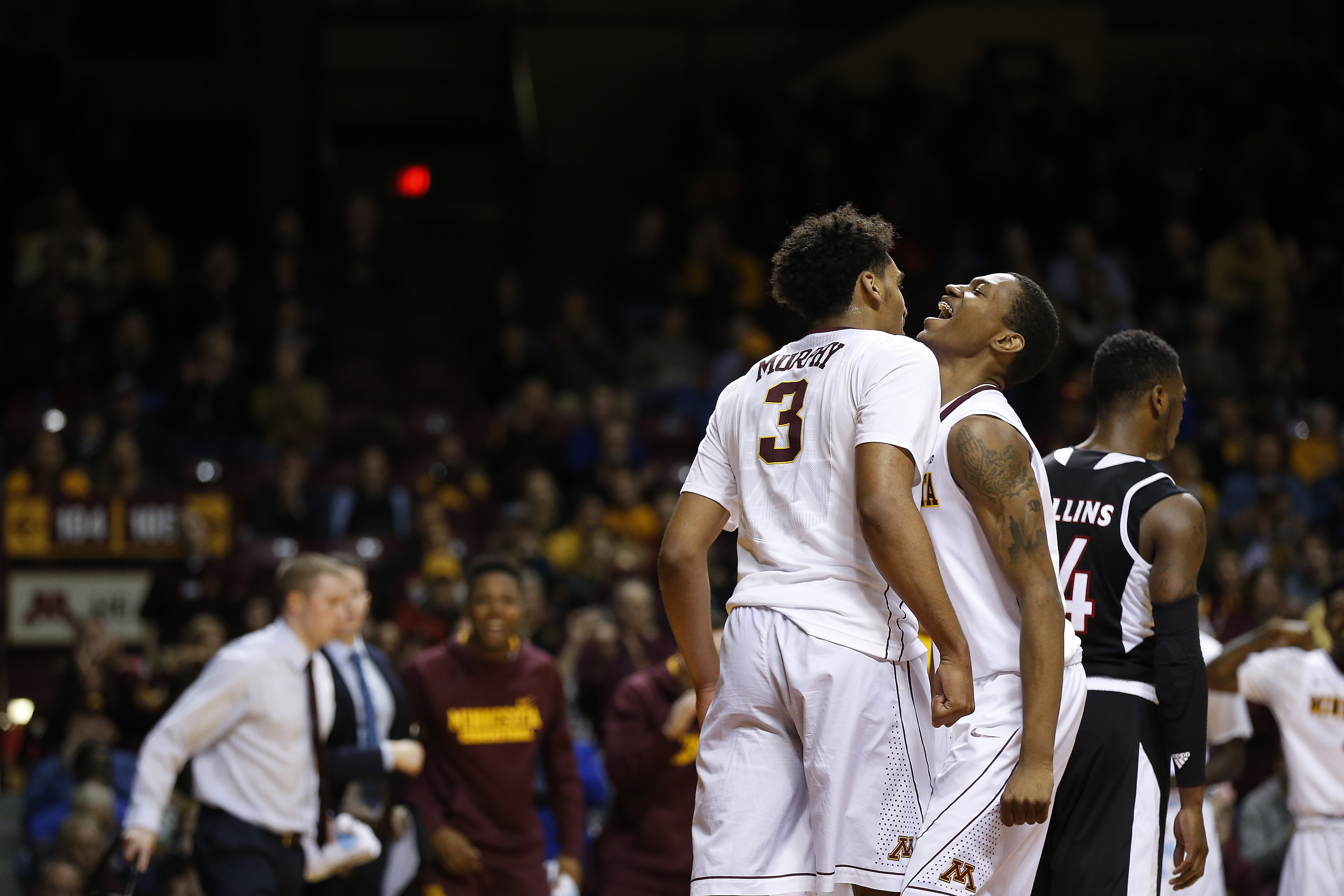 Minnesota forward Jordan Murphy (3) celebrates with teammate guard Dupree McBrayer, right, in the second half of an NCAA college basketball game against Nebraska-Omaha, Friday, Nov. 27, 2015, at Williams Arena in Minneapolis. (AP Photo/Stacy Bengs)