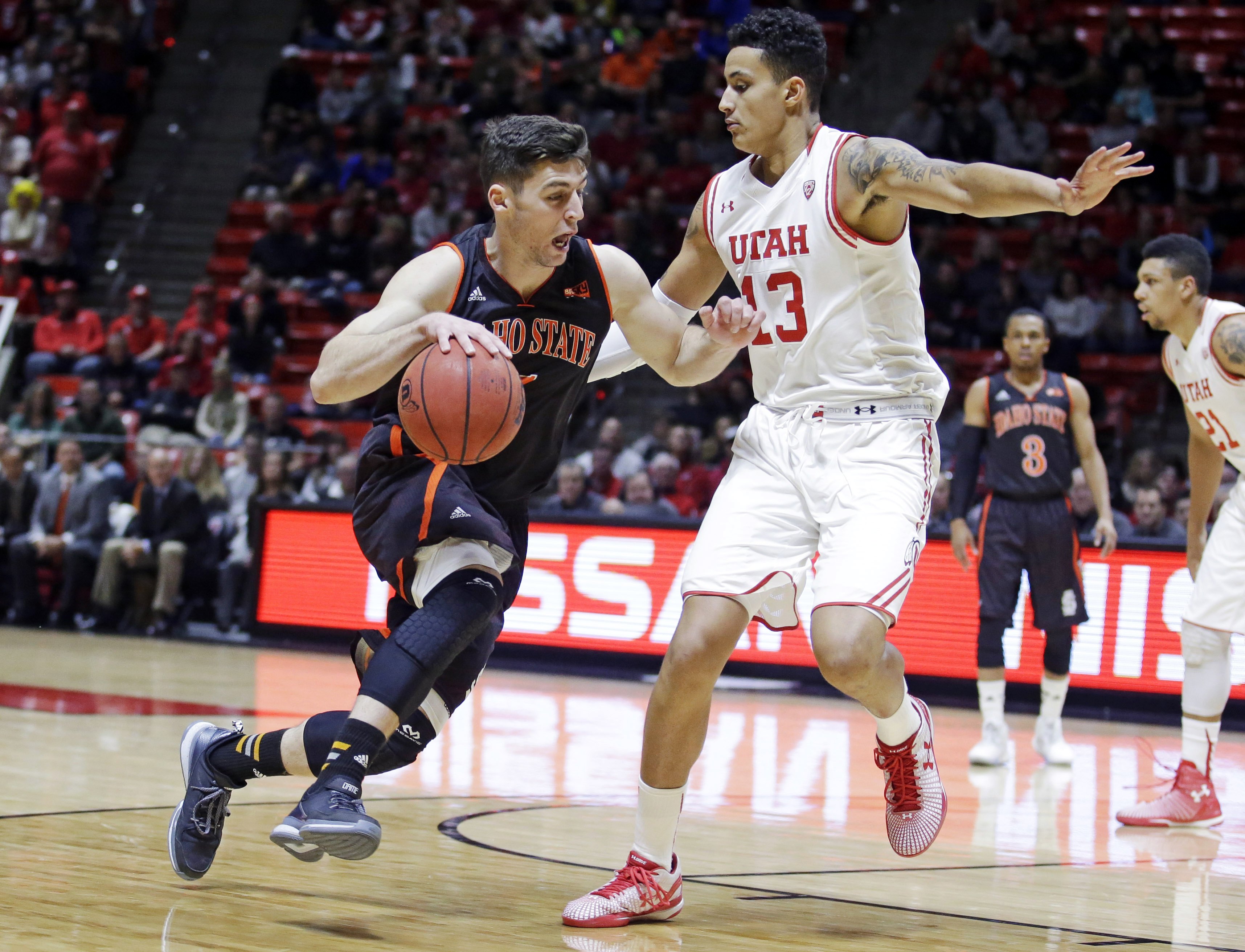 Idaho State guard Ben Wilson, left, drives around Utah forward Kyle Kuzma (13) in the first half during an NCAA college basketball game Friday, Nov. 27, 2015, in Salt Lake City. (AP Photo/Rick Bowmer)