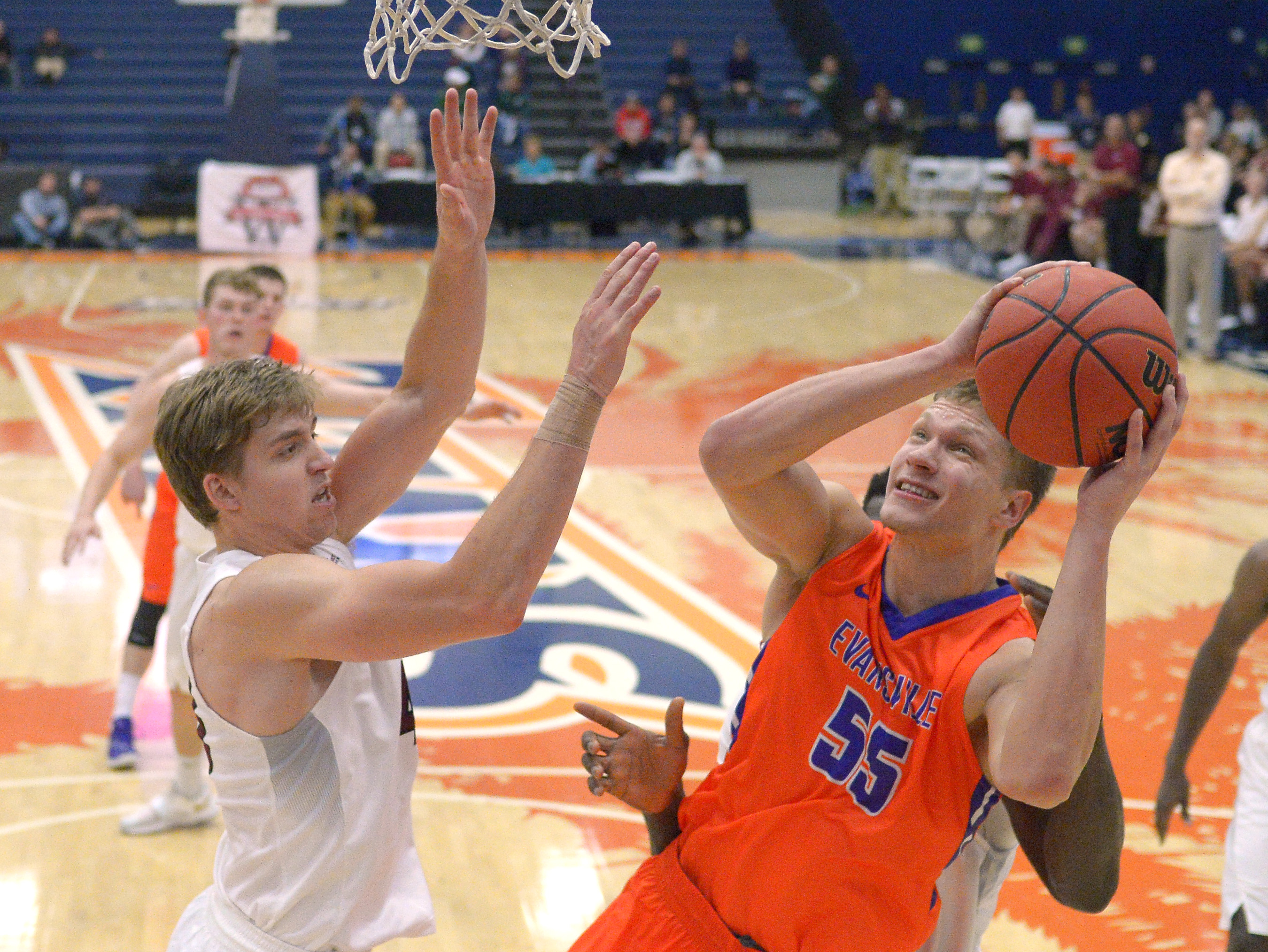 Evansville center Egidijus Mockevicius, right, shoots as Santa Clara forward Nate Kratch defends during the second half of an NCAA college basketball game at the Wooden Legacy tournament Friday, Nov. 27, 2015, in Fullerton, Calif. Evansville won 69-57. (A