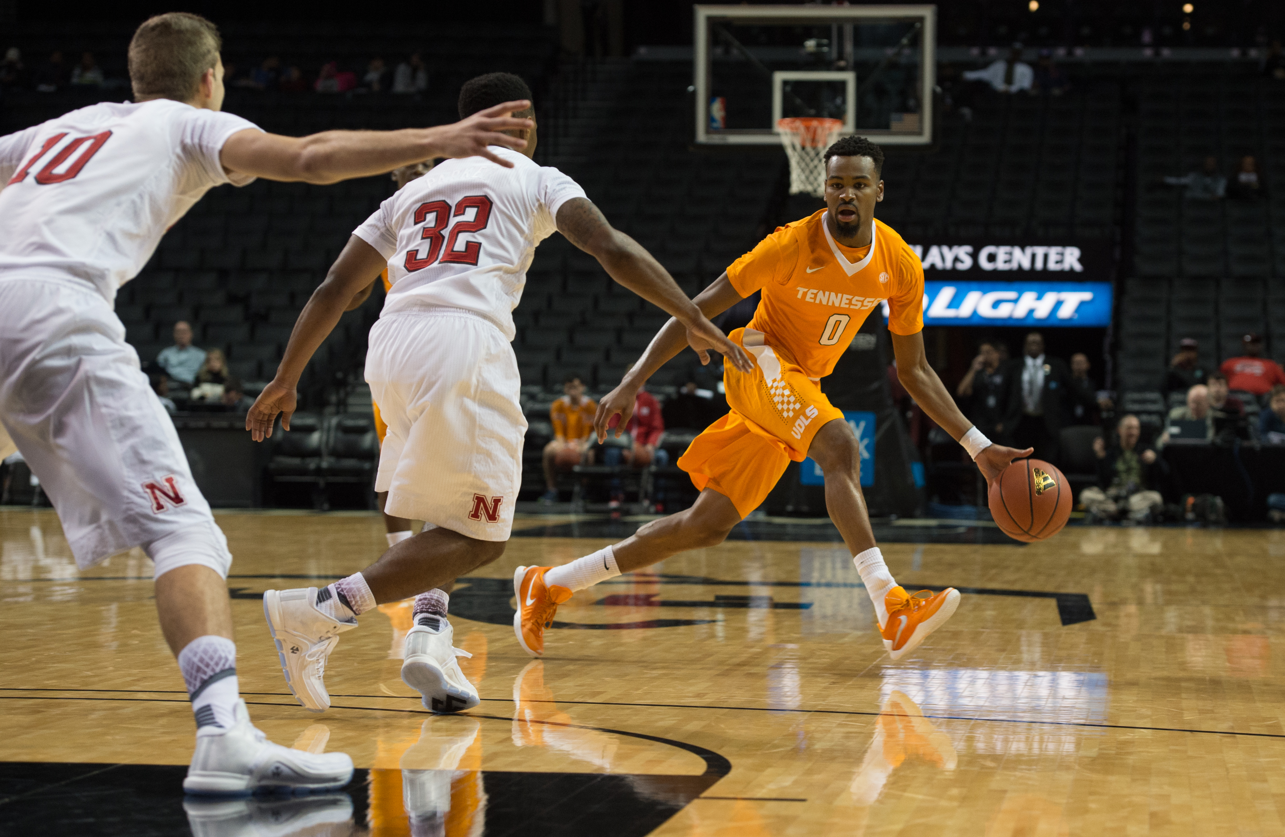Tennessee guard Kevin Punter (0) dribbles the ball against Nebraska guard Benny Parker (32) and forward Jack McVeigh (10) during the first half of an NCAA college basketball game in the consolation game at the Barclays Center Classic, Saturday, Nov. 28, 2