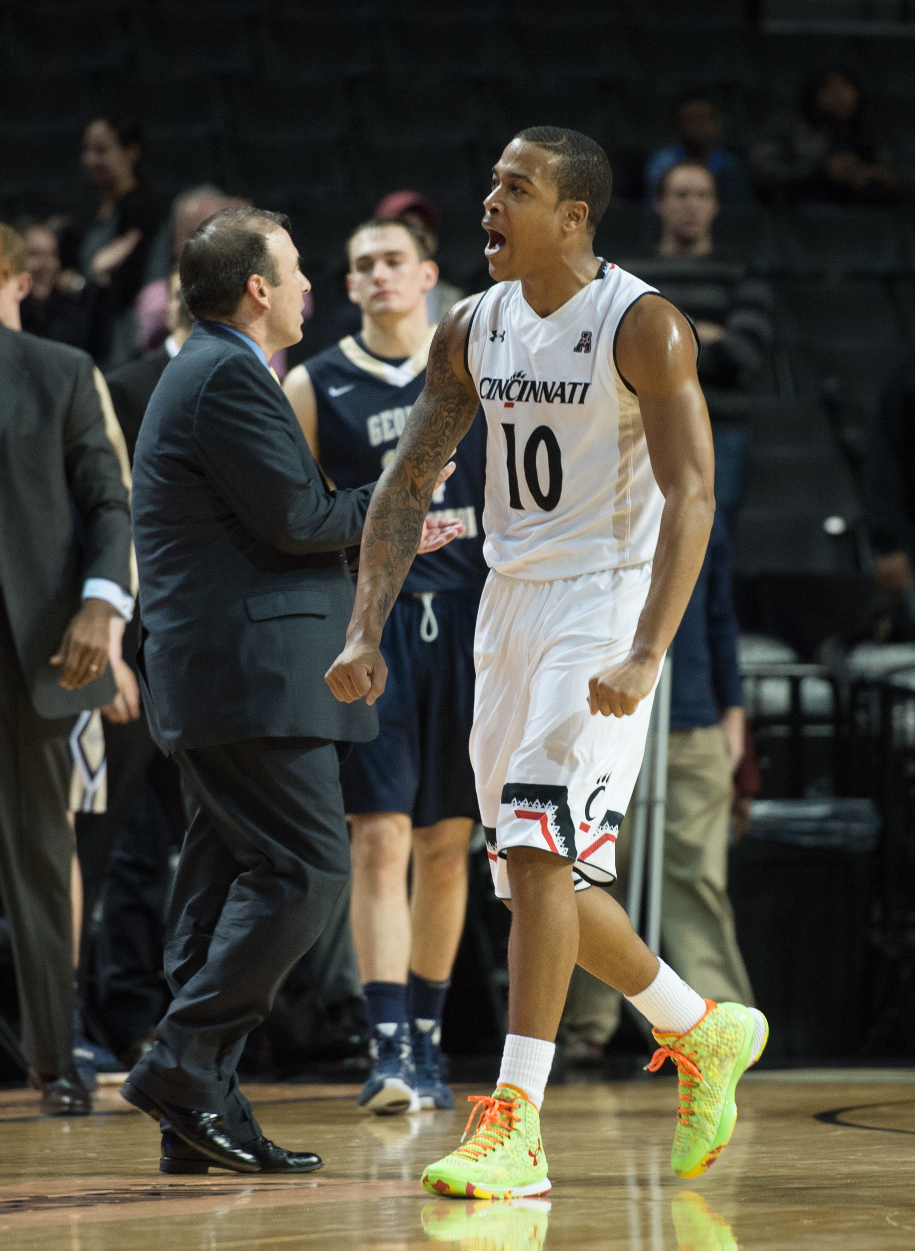 Cincinnati guard Troy Caupain (10) celebrates after their 61-56 win over George Washington in an NCAA college basketball game in the championship game at the Barclays Center Classic, Saturday, Nov. 28, 2015, in New York. Cincinnati won 61-56. (AP Photo/Br