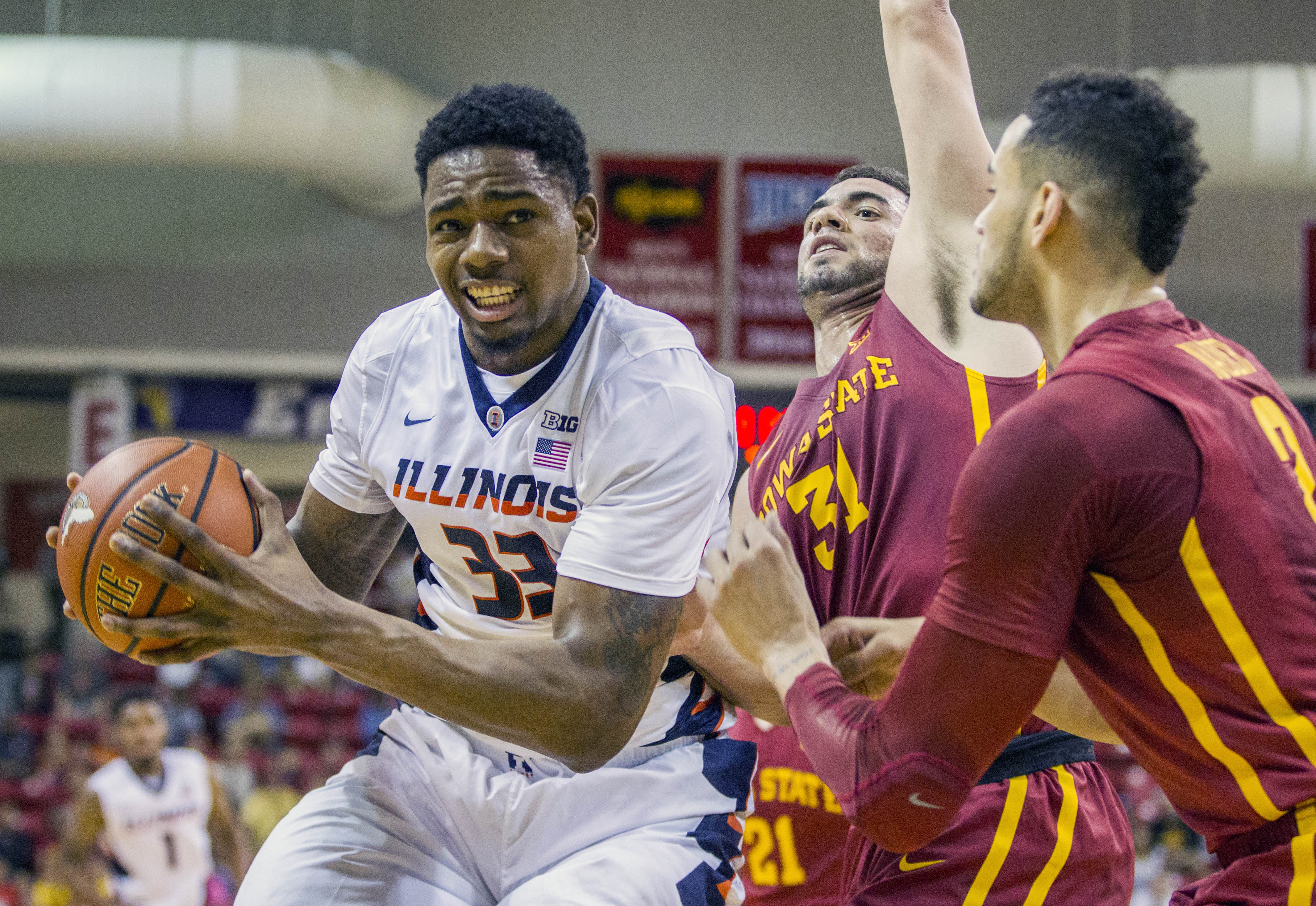 Illinois center Mike Thorne, Jr. tries to take a shot against Iowa State's Abdel Nader, right, and George Niang in the first half of an NCAA college basketball game during the Emerald Coast Classic in Niceville, Fla., Saturday, Nov. 28, 2015.  (AP Photo/M