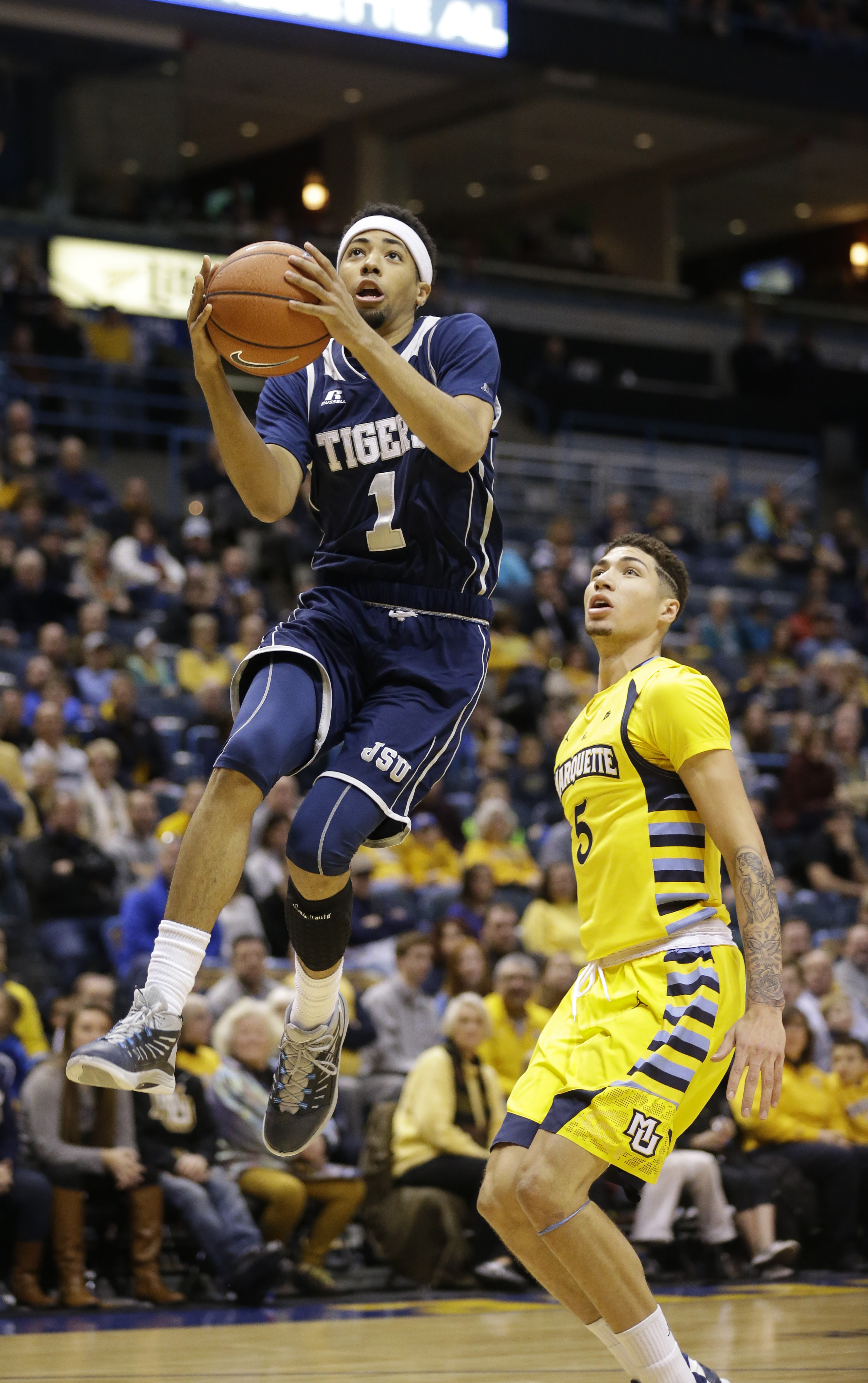 Jackson State's Chace Franklin (1) drives to the basket against Marquette's Sandy Cohen III in the first half of an NCAA college basketball game Sunday, Nov. 29, 2015, in Milwaukee. (AP Photo/Jeffrey Phelps)
